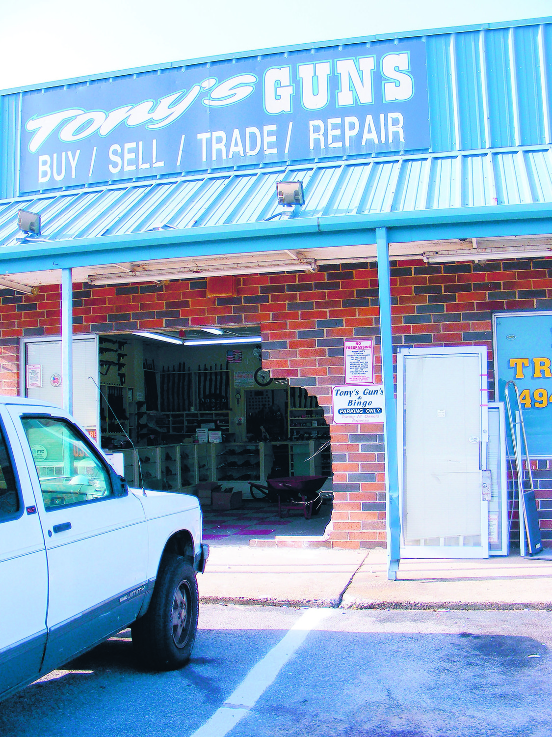 SUMTER ITEM FILE PHOTOThe front of Tony's Guns on Broad Street is shown a few hours after an August 2016 robbery. According to store owner, Tony Ashy, the perpetrator(s) backed a pickup truck into the building to gain access to the weapons.