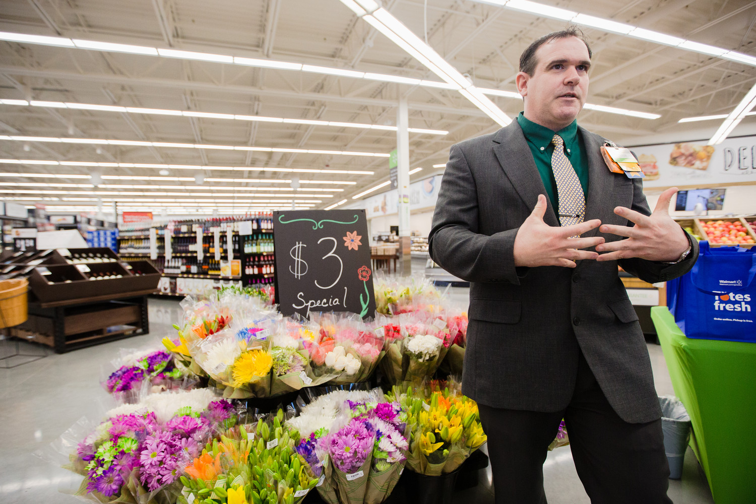 Adam Bunker, manager at the new Walmart Neighborhood Market, gives a tour of the store on Tuesday.