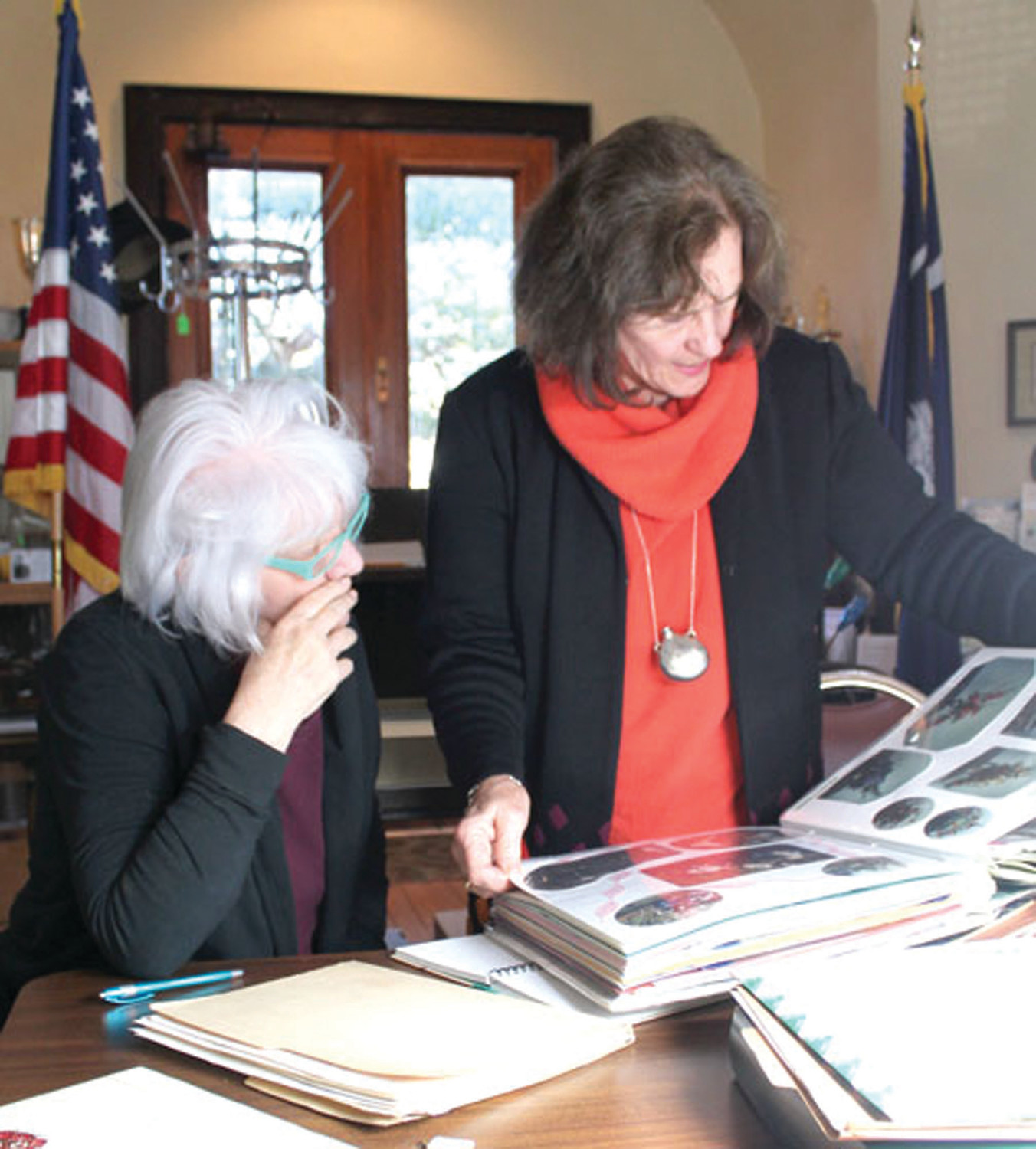 SHARRON HALEY / SPECIAL TO THE SUMTER ITEMGinny Honea, left, president of the Azalea Garden Club of Manning, and Marie Land, a former president and member of the club, sort through albums teeming with club pictures and history that the club donated to the Clarendon County Archives. Club members are planning a private celebration of the club's 70th anniversary in March at the exact spot where the club was founded seven decades ago on the front porch of the Weinberg home on North Brooks Street that now belongs to Julian and Jessica Weinberg.