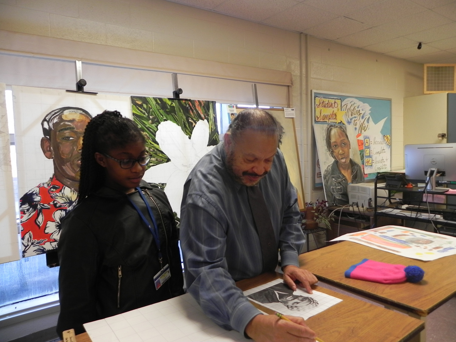 Tarleton Blackwell instructs student Dae' Sha Green about techniques for completing her portrait of Harriet Tubman. His students' work is featured at the Lake Marion Artisans Gallery during Black History Month.
