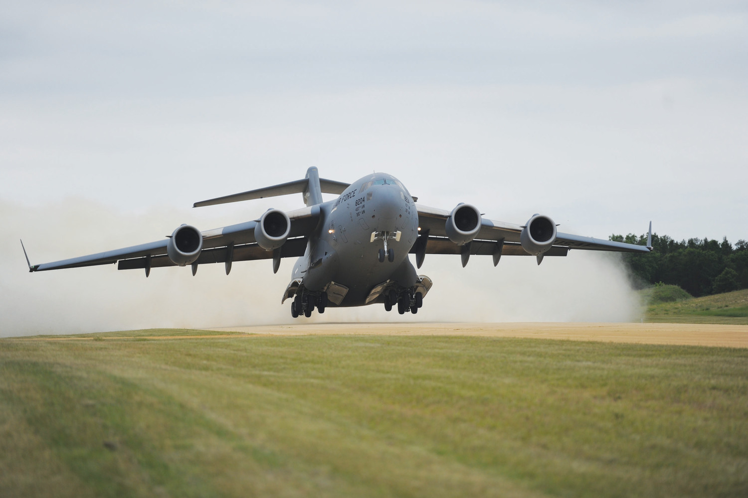 A C-17 Globemaster from the 437th Airlift Wing out of Joint Base Charleston takes off from the gravel runway at the Young Air Assault Strip in Fort McCoy, Wisconsin, in 2016.  Capt. Kayla Hill is a C-17 pilot.