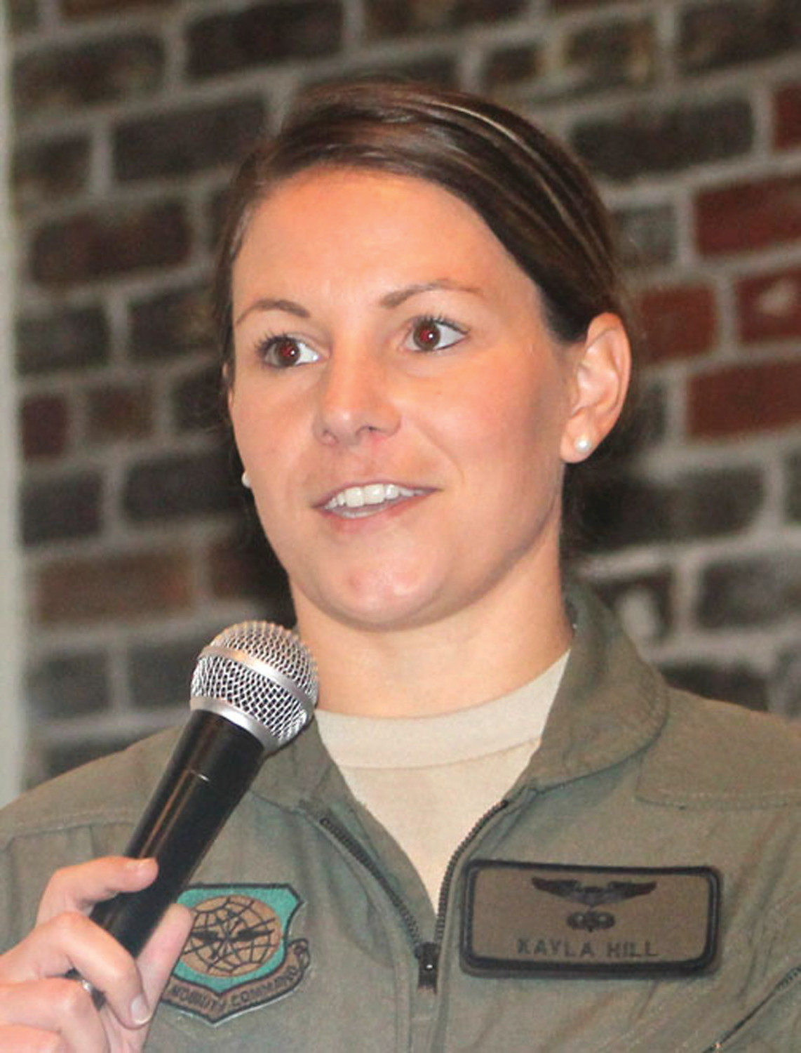 "Air Force Capt. Kayla Hill wanted to be a gymnast growing up. It wasn't until her thoughts turned to college did she give flying a thought. Her college counselor suggested a career in the Air Force, but she had to convince her mother first. Hill thought flying was ""kinda cool"" and took her first lessons in a Cessna. She applied at the Air Force Academy, and her talents as a gymnast helped pave the way."