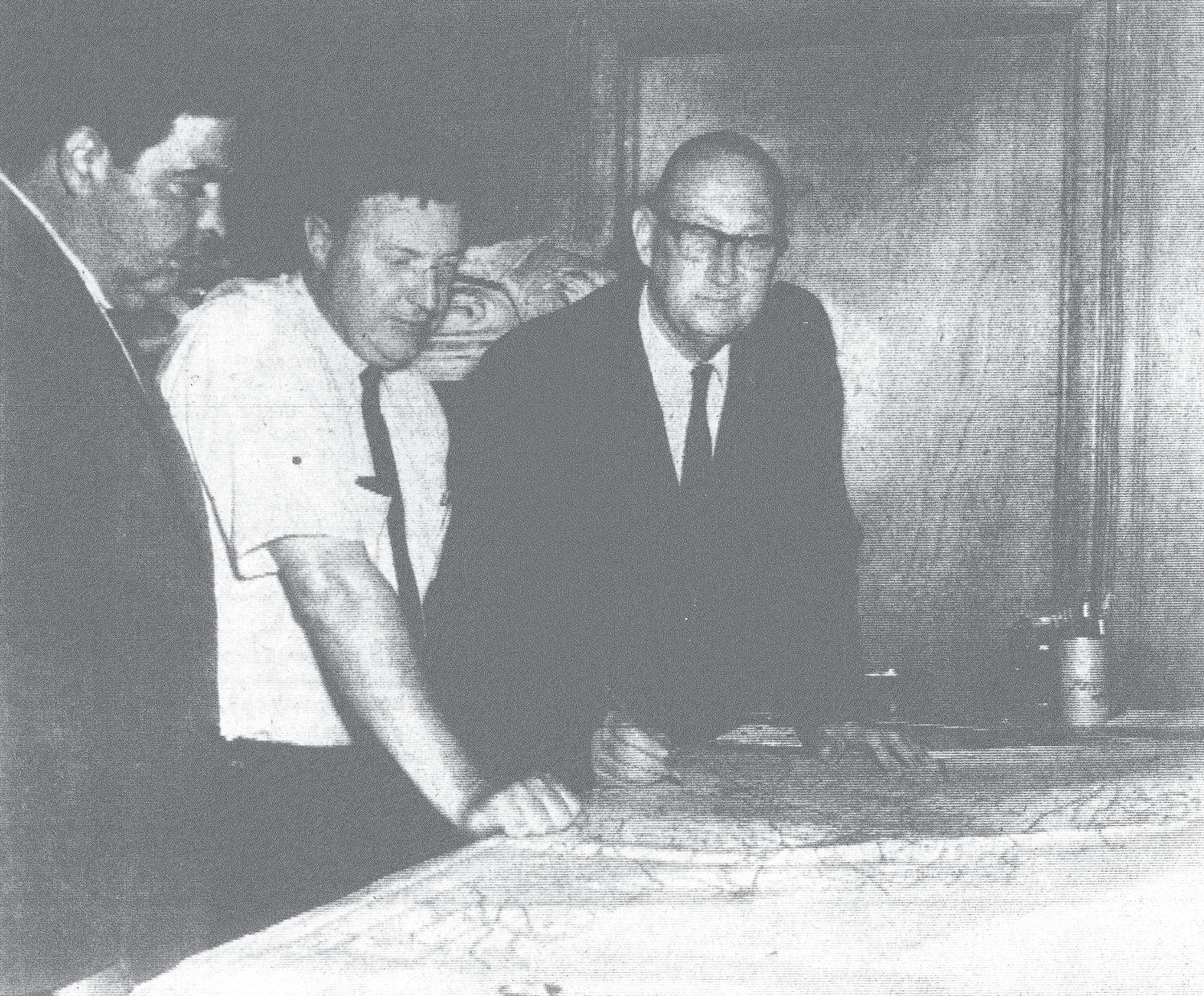 1968 - Base mapping, the first phase of comprehensive planning studies of Sumter County, is charted by, from left, Ed Gussio and Don Johnson, planning director and technician, respectively, and James Nettles, chairman of the County Planning Board.