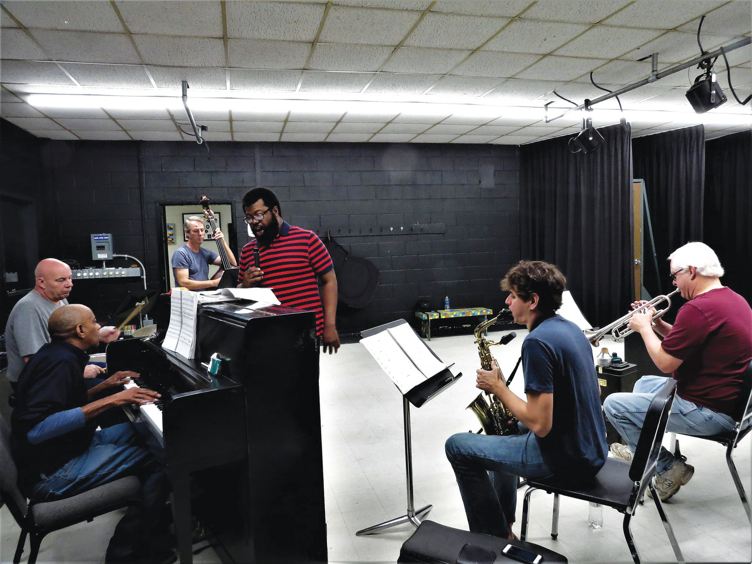 "William Paul Brown rehearses a solo accompanied by James Lies on piano, David Shoemaker on drums, Darren Polutta on bass, Sean Hackett on sax and Robert Berry on trumpet. The ""Five Guys Named Moe"" band also includes drummer Barry Simpson and  Chip Scales on trombone. The musical comedy directed by Eric Bultman opens Thursday at   Sumter Little Theatre."