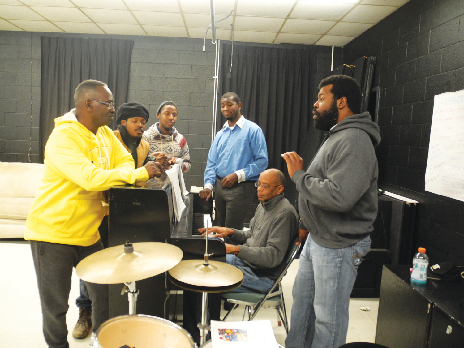 "Pianist James Lies accompanies cast members of ""Five Guys Named Moe"" as they rehearse one of 21 songs in the musical comedy. From left, the actors are Hugh China, Josh Thomas, Markelle Roberts, Brandon Graves and William Paul Brown. The show features the music of Louis Jordan and several of his contemporaries."