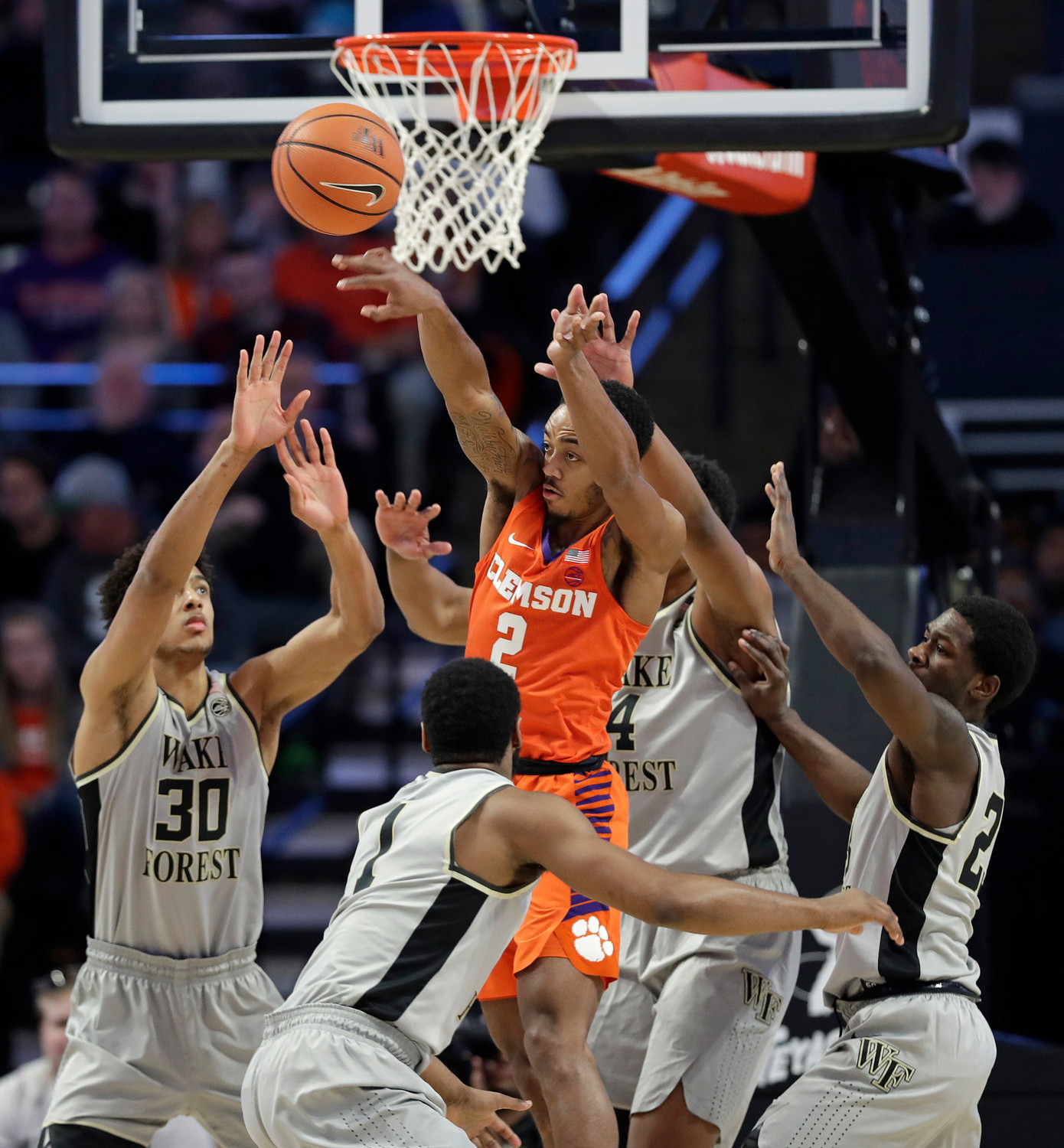 Clemson's Marcquise Reed (2) passes the ball over Wake Forest players during the first half of the Tigers' 75-67 victory over the Demon Deacons on Saturday in Winston-Salem, North Carolina.