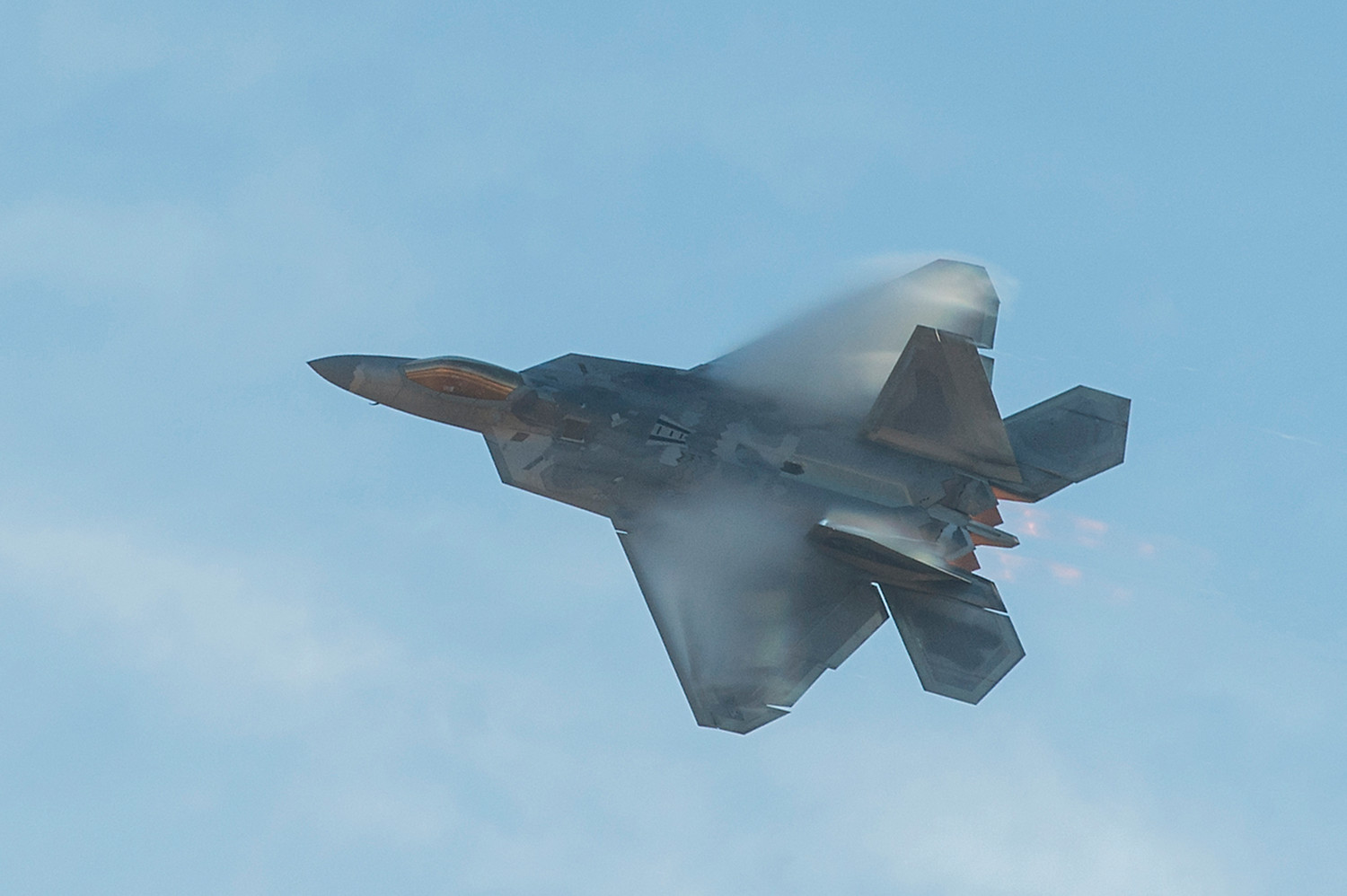 An Air Force F-22 Raptor stealth fighter is shown during an aerial combat capability demonstration at Shaw Air Force Base on Nov. 30, 2017. Defense contractor employees of Lockheed Martin, who produces the Raptor, are among the hacking targets of Russian cyberspies.