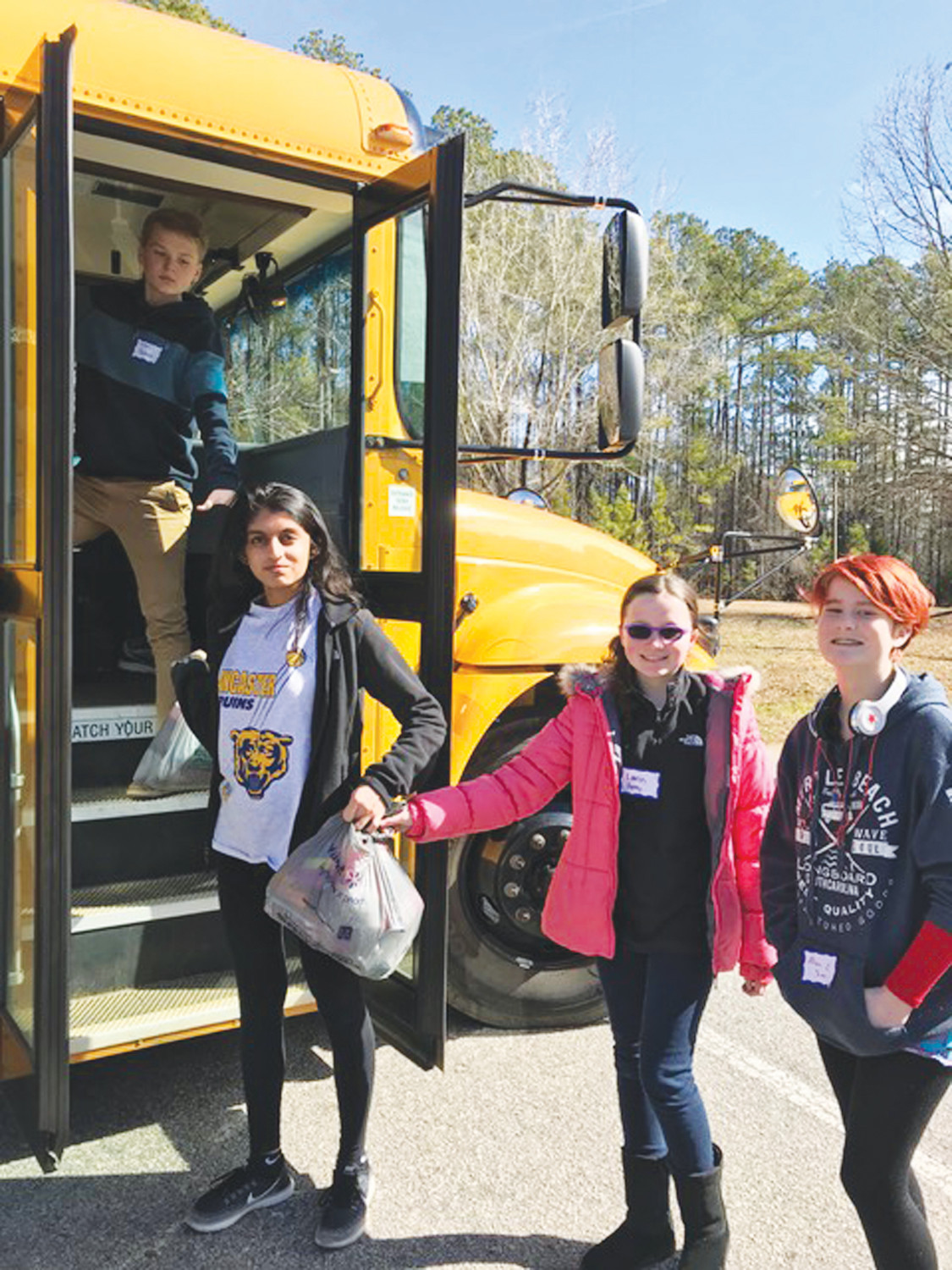 Sumter High, Crestwood High and Hillcrest Middle schools participated in the Jr. Civitan Winter Service Project at Saluda Shoals Park, Irmo, recently. Items were donated to Oliver Gospel Mission in Columbia. The group learned about the needs of the homeless population and donated a total of 583 items. From left are Connor Parman and Jankie Patel of Lancaster High School and Lauren Feeney and Allison Sims of Hillcrest Middle School.
