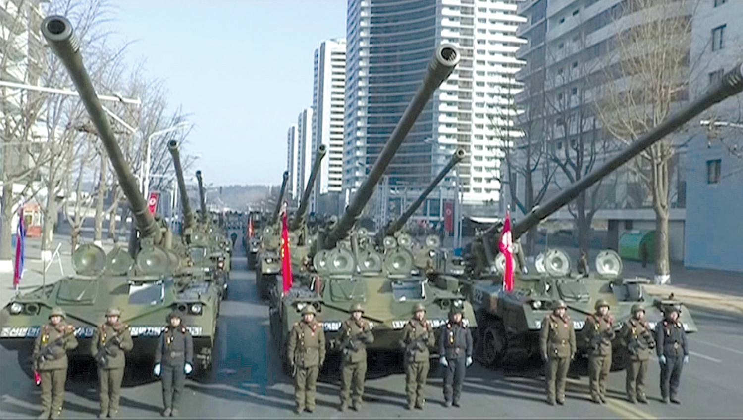 In this image made from video by North Korea's KRT military tanks are seen during a parade in Pyongyang North Korea on Thursday. North Korea held a military parade and rally on Kim Il Sung Square just one day before South Korea hosts the opening ceremo