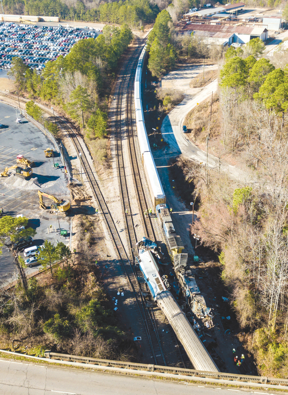 The site of Sunday's early morning train crash between an Amtrak train, bottom, and a CSX freight train, top left, is seen in Cayce.