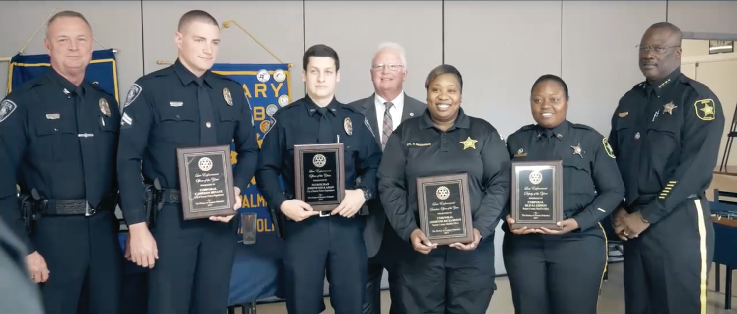 Officer of the year award recipients stand with their agency leaders. From left are Sumter Police Chief Russell Roark III; police officers of the year, lead Cpl. Cameron Bryant and patrolman Joseph Kellahan; corrections officer of the year Cpl. Adrienne Richardson; sheriff's deputy of the year Cpl. Olivia Gibson; and Sumter County Sheriff Anthony Dennis. South Carolina Highway Patrol trooper of the year, trooper Kevin Boland, is not pictured.