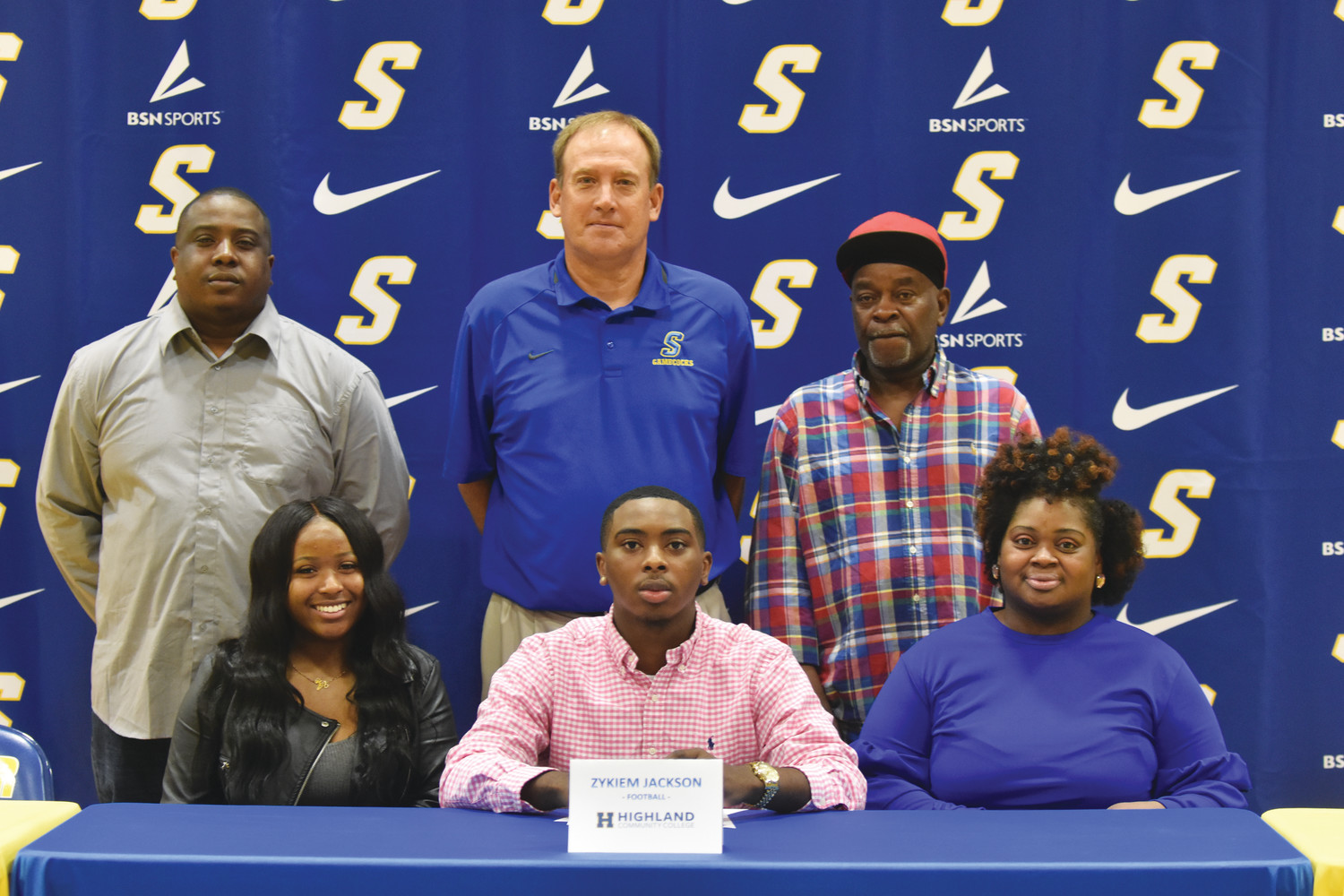 Sumter High quarterback Zykiem Green signed a letter of intent on Wednesday during National Signing Day to play college football at Highland Community College in Highland, Kansas. Green is seen with his mother, Lashawda Jackson (front right), grandfather Willie Prince (back right), Sumter High head coach Mark Barnes (back middle), father Robert Jackson (back left) and girlfriend Jalisa Toney (front left).