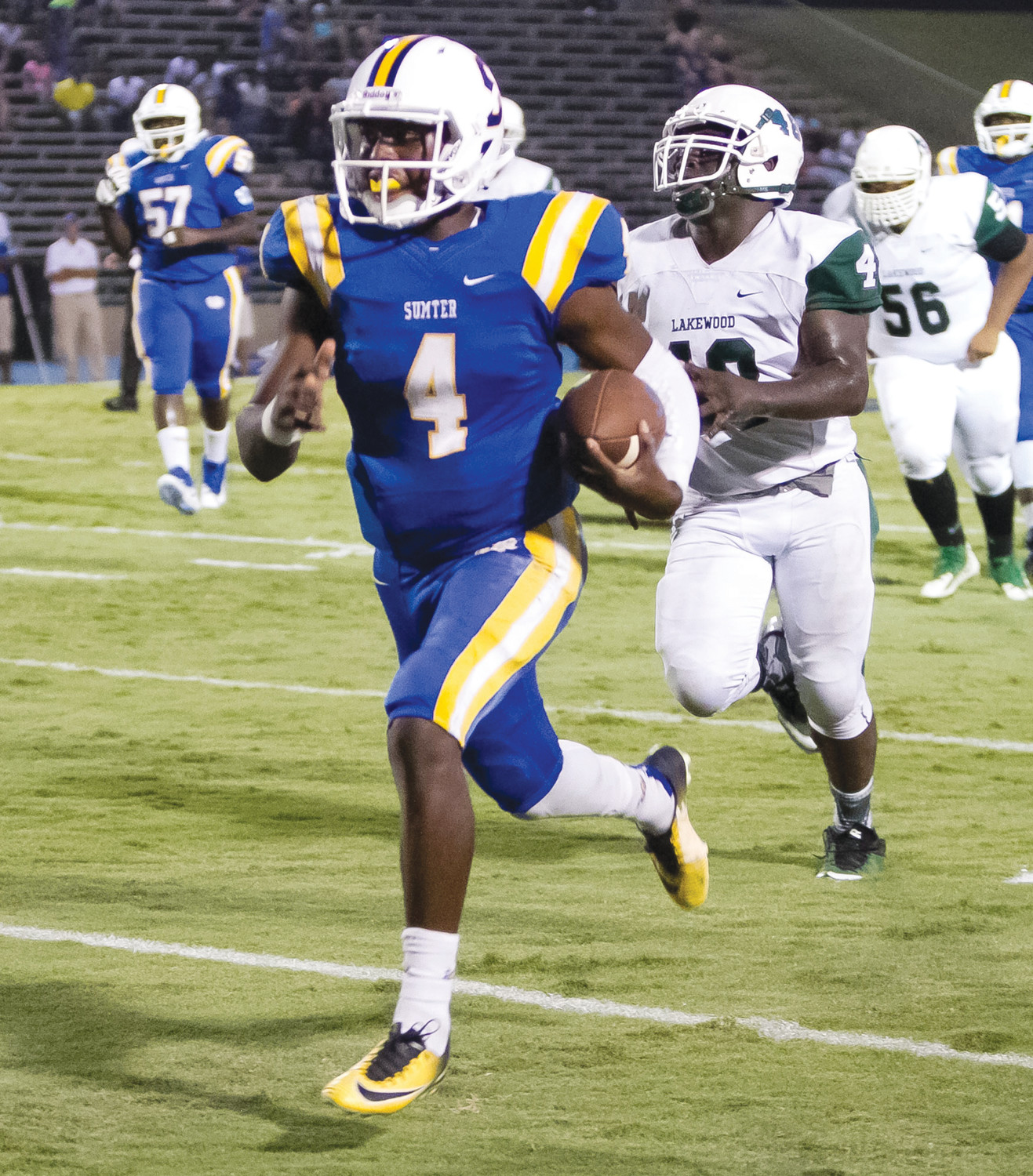 Sumter High quarterback Zykiem Jackson (4) gets away from the Lakewood defense during their 2017 game at Sumter High's Memorial Stadium. Jackson signed a letter of intent on Wednesday to play football at Highland Community College in Highland, Kansas.