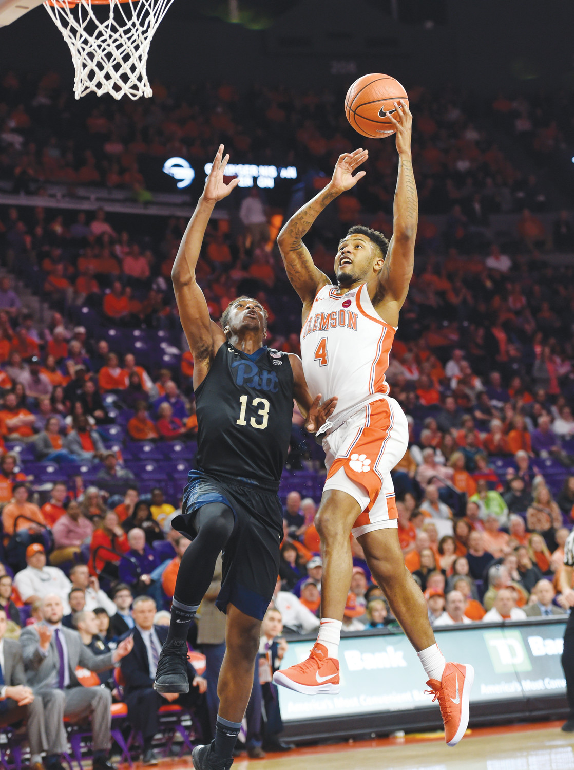 Clemson's Shelton Mitchell (4) drives in to score while defended by Pittsburgh's Khameron Davis during the first half of the Tigers' 72-48 victory over the Panthers on Thursday in Clemson.