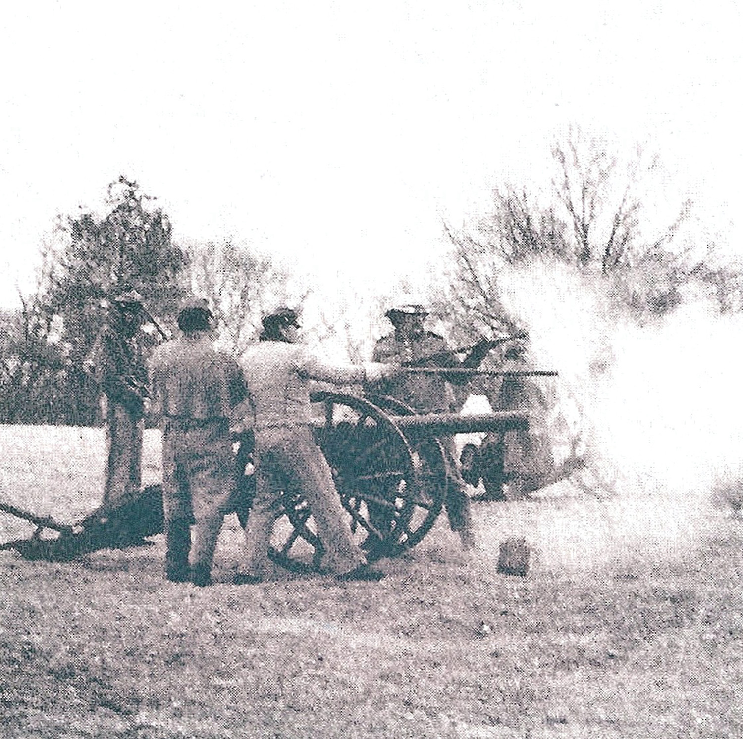 Reenactors of the Battle of Dingle's Mill shoot a cannon. The unknown soldier died from injuries sustained during that battle during the Civil War.