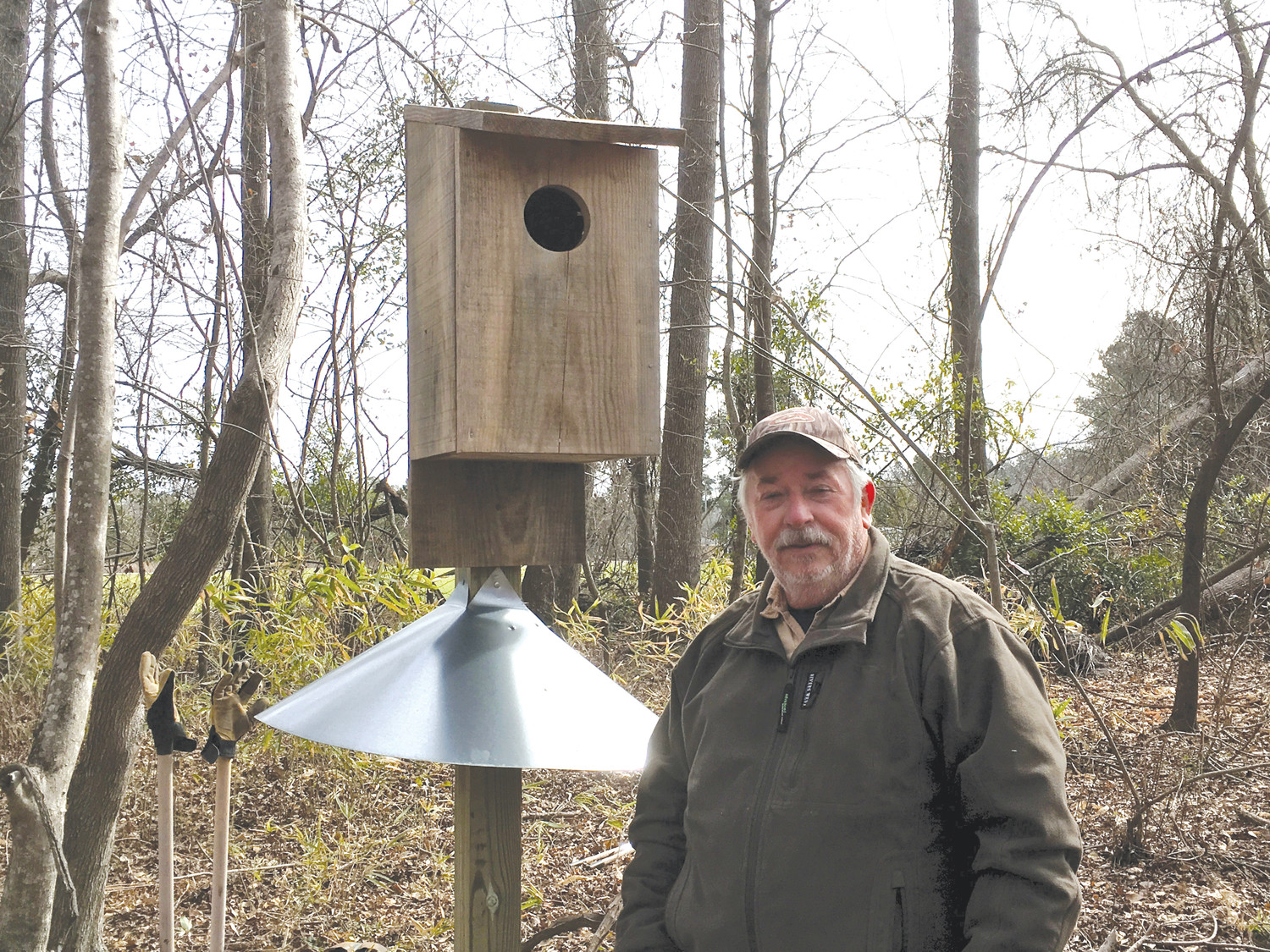 PHOTO PROVIDEDDan Geddings is seen at a newly installed wood duck nest box.