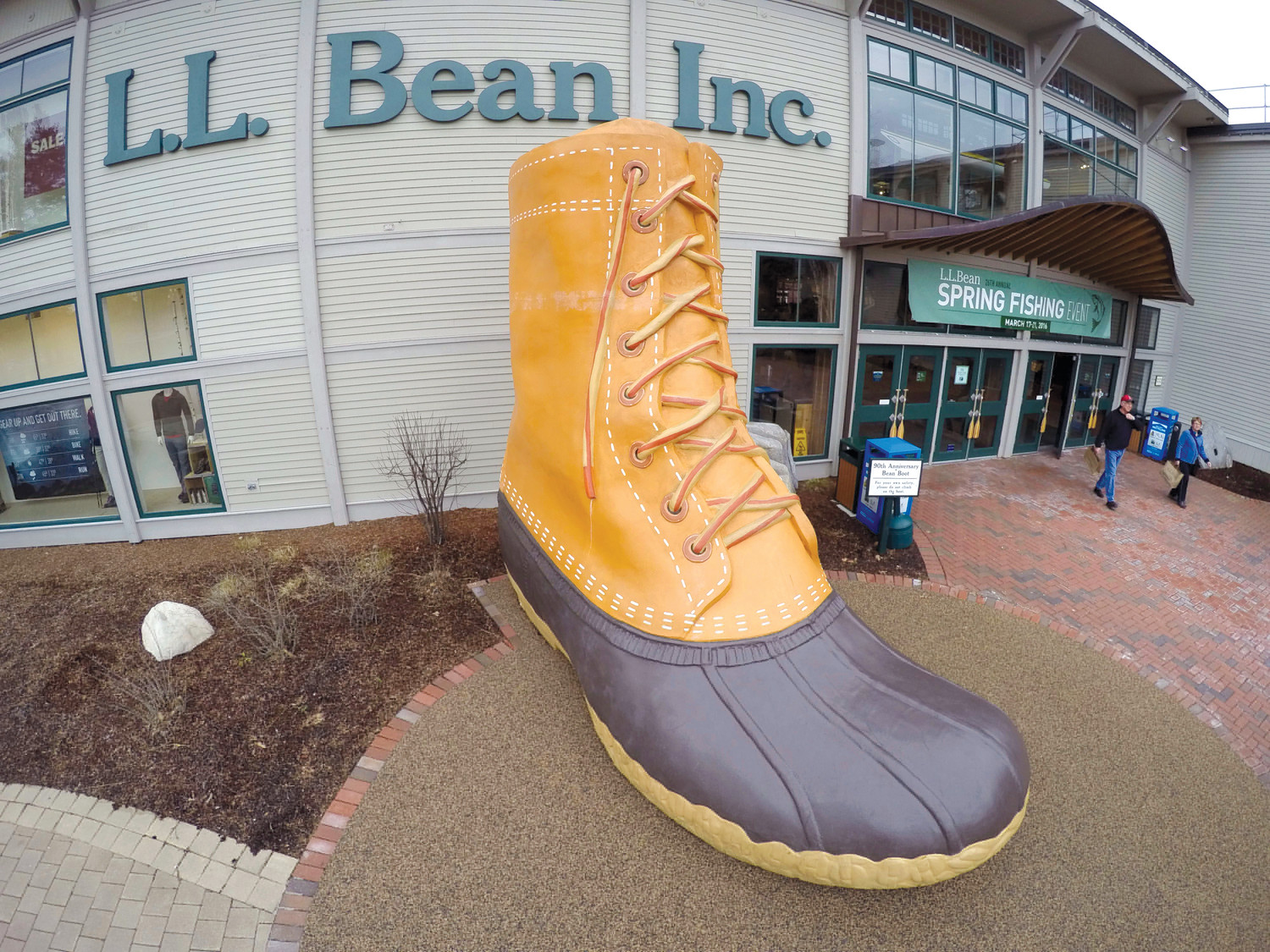 AP FILE PHOTOShoppers exit the L.L. Bean retail store in Freeport, Maine, in 2016. L.L. Bean is tightening its generous return policy by imposing a one-year limit on most returns to reduce abuse and fraud.