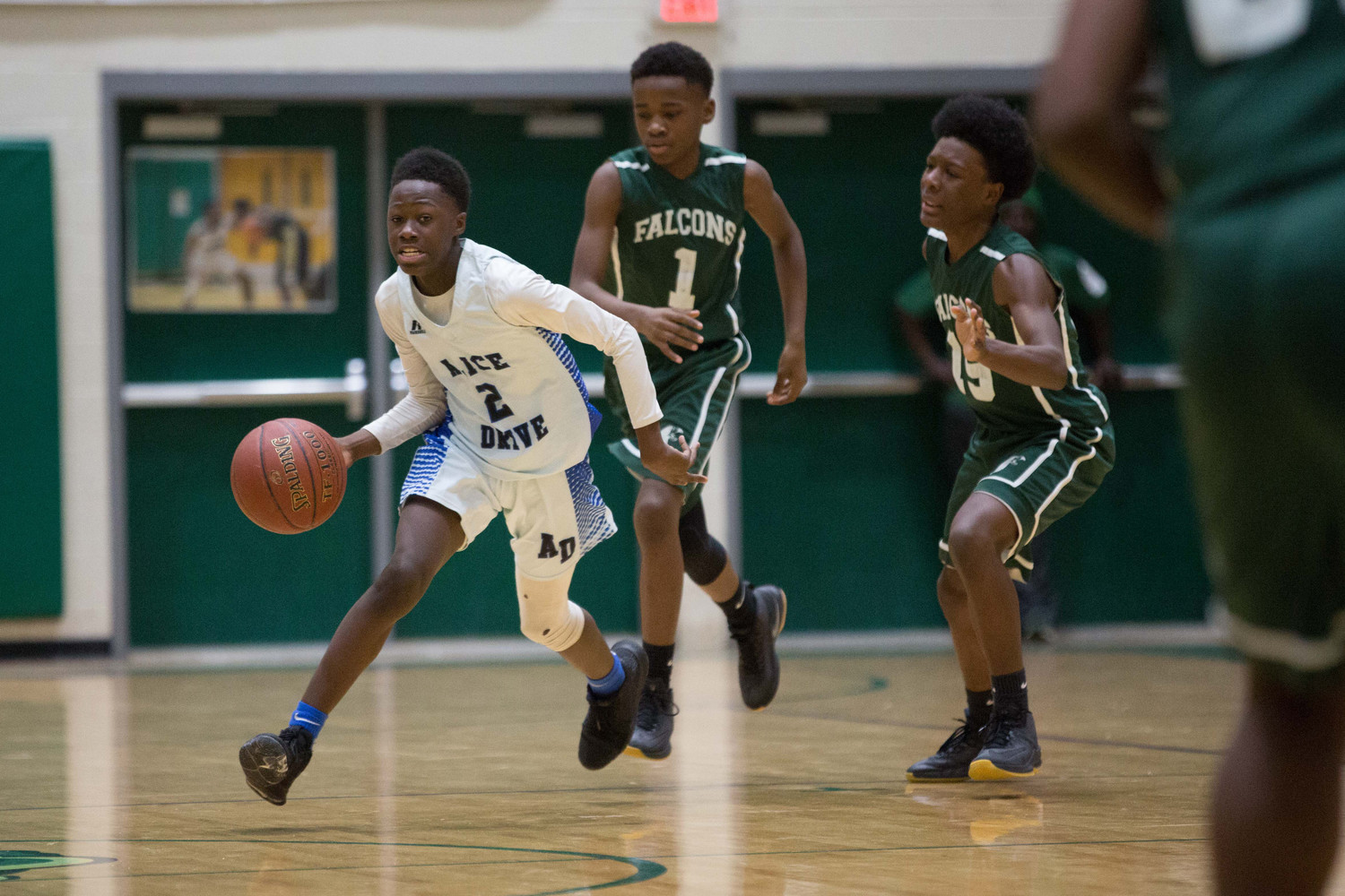 Alice Drive's Joseph Durant drives the ball down court as Chestnut Oaks defenders pursue during the Hawks' victory in the Sumter Middle School Conference basketball tournament on Saturday at Lakewood High's The Swamp.
