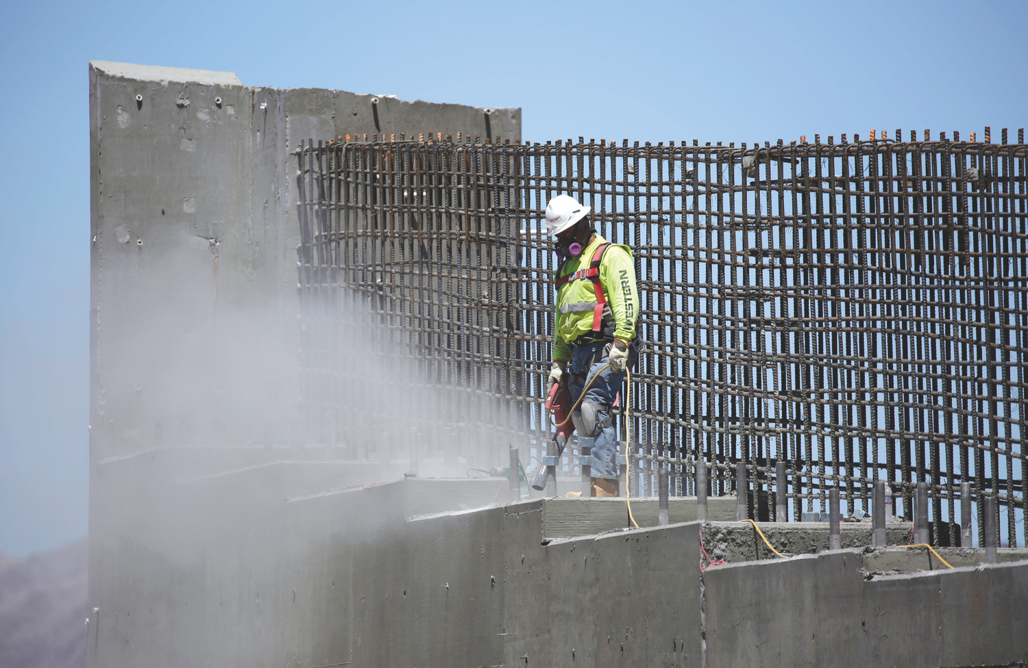 A man works on the Southern Nevada portion of U.S. Interstate 11 near Boulder City, Nevada, in May 2017.