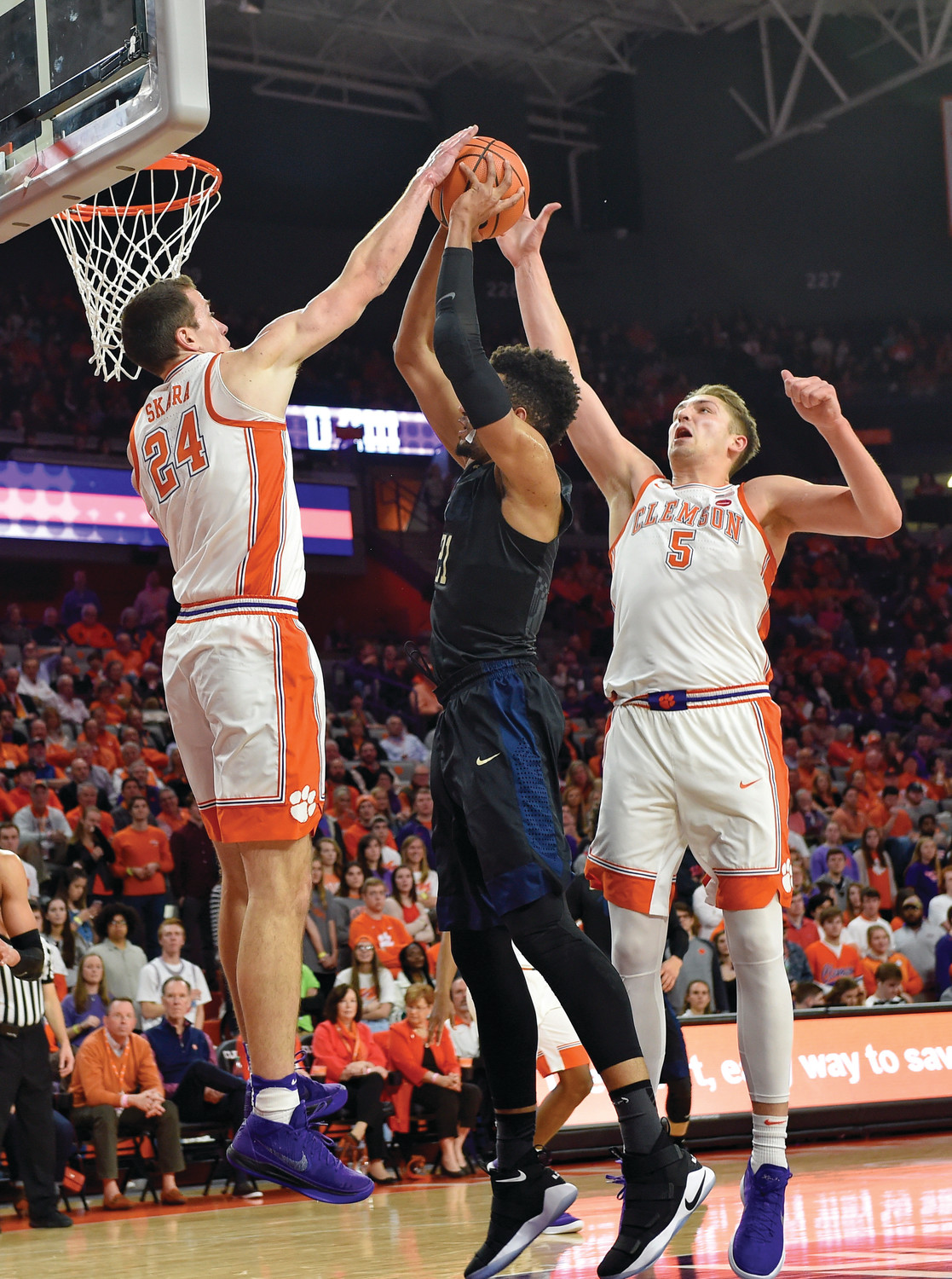 Clemson's David Skara (24) and Mark Donnal (5) both block the shot of Pittsburgh's Terrell Brown during the Tigers' 72-48 victory on Thursday in Clemson. The Tigers moved up to No. 11 in The Associated Press Top 25 poll released on Monday.