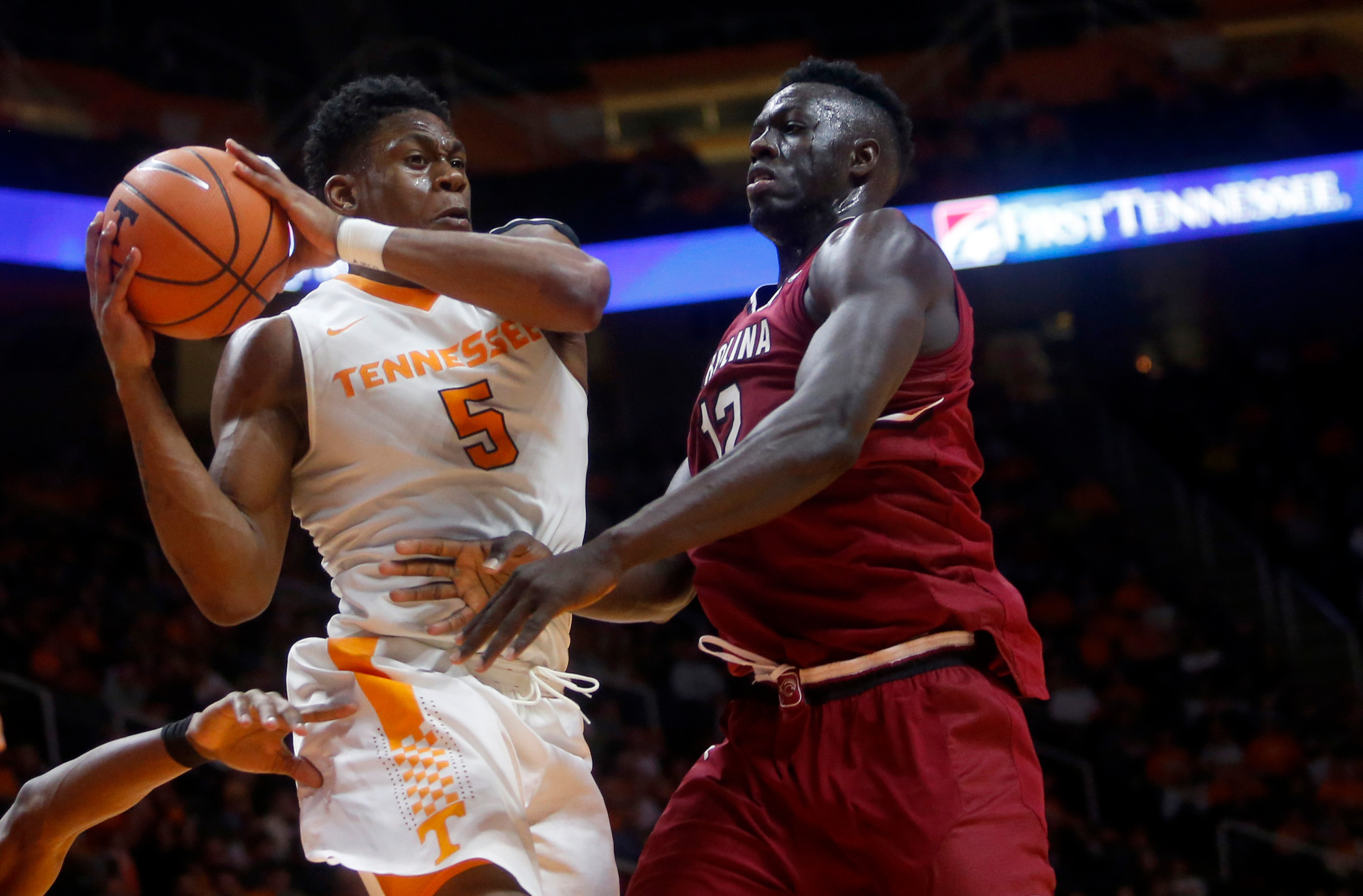 Tennessee forward Admiral Schofield (5) grabs the ball in front of South Carolina forward Khadim Gueye (12) in the Volunteers' 70-67 victory on Tuesday in Knoxville, Tenn.