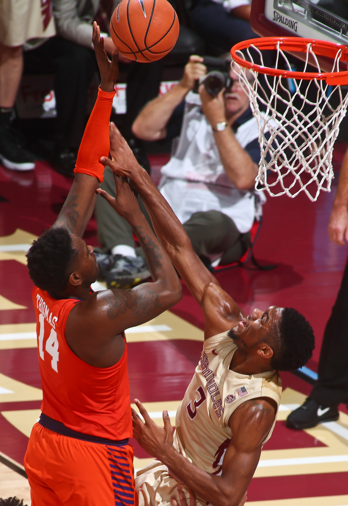 Clemson forward Elijah Thomas (14) makes a layup as he is fouled by Florida State guard Trent Forrest (3) during the Tigers' 81-79 loss on Wednesday in Tallahassee, Fla.