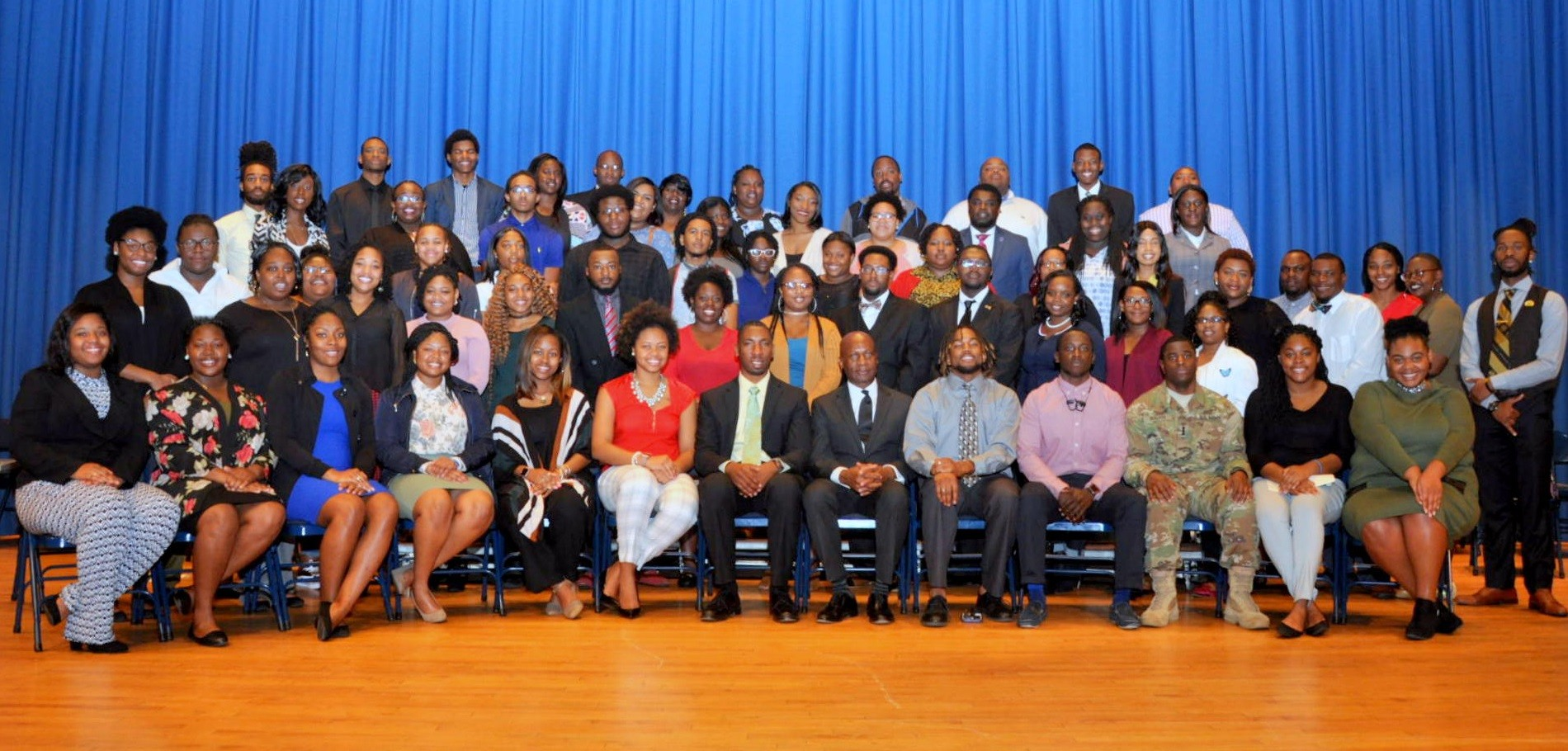 Howard Conyers, keynote speaker, sits for a photo with the Morris College honors students recognized on Thursday with Interim President Leroy Staggers to his left.