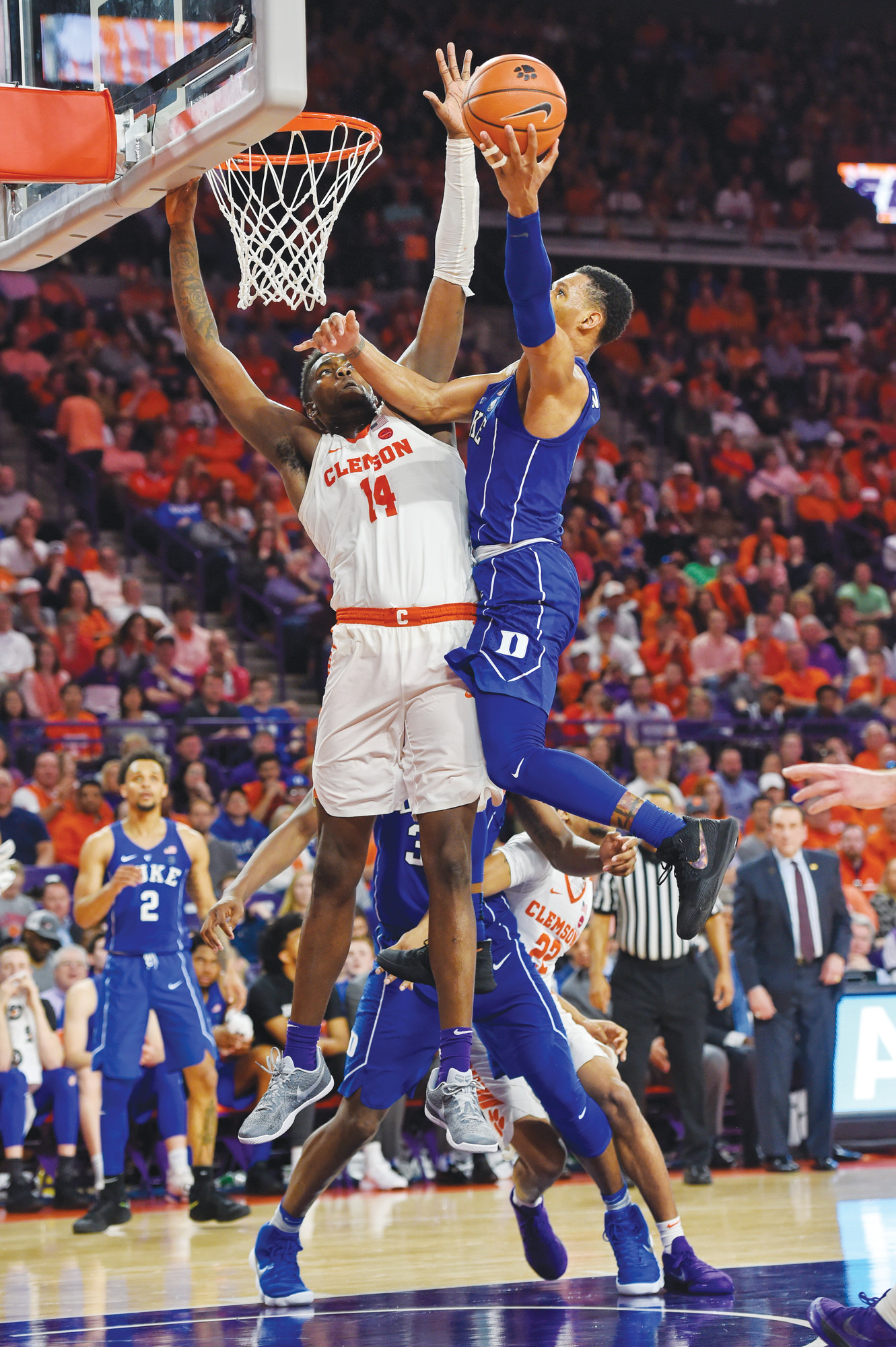 Duke's Trevon Duval, right, drives to the basket while defended by Clemson's Elijah Thomas during the second half of the Blue Devils 66-57 victory over the Tigers on Sunday in Clemson.