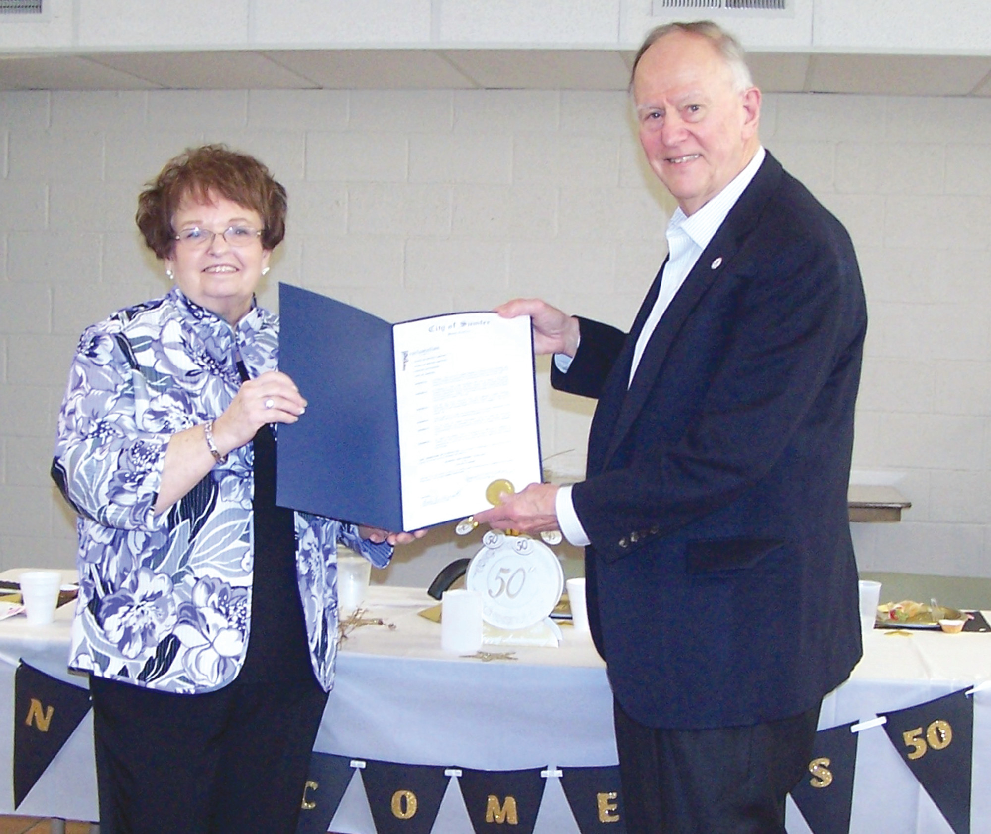 Arlene Janis, president of the Sumter Newcomers Club, accepts the official proclamation of Feb. 28 as Sumter Newcomers Club Day from Sumter Mayor Joseph T.  McElveen. McElveen made the proclamation at the club's breakfast at the Spectrum senior center on Friday, Feb. 9.