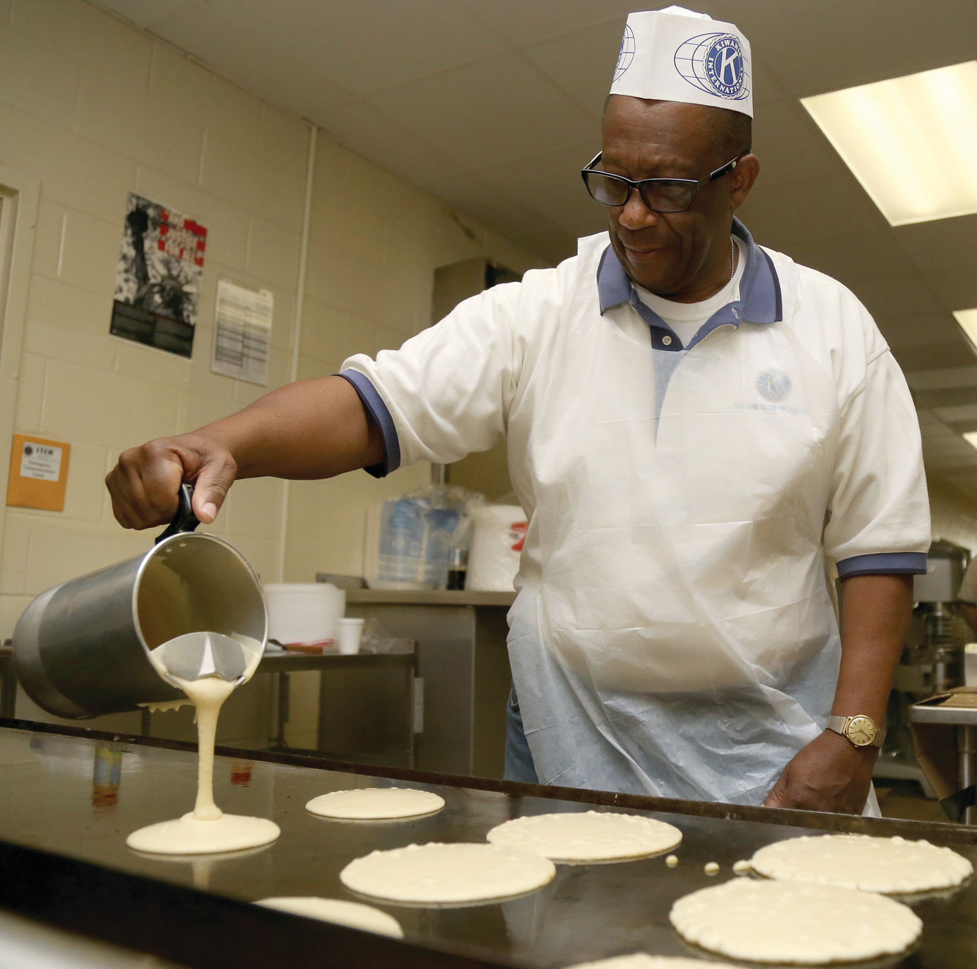 Don Beard pours pancakes at a past Sumter Kiwanis Pancake Day at Alice Drive Middle School. This year's event will be held on Saturday, March 3.