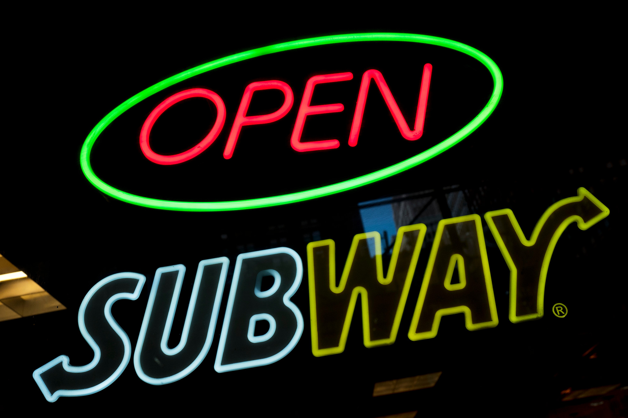 A Subway fast food restaurant's sign is shown in New York. Subway is changing up its loyalty program, letting customers earn $2 discounts instead of free Footlong sandwiches. The change, taking place in March 2018, is part of Subway's plan to lure people back to the sandwich chain.