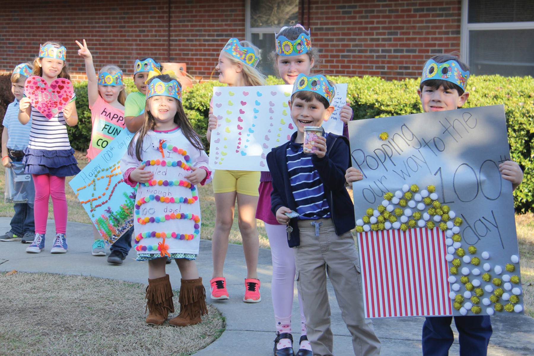 Wilson Hall kindergarten students celebrate their 100th day of school with a parade through the campus. Each kindergarten student made something with 100 items to commemorate the milestone and then gave a presentation about his or her creation to the first-grade classrooms.