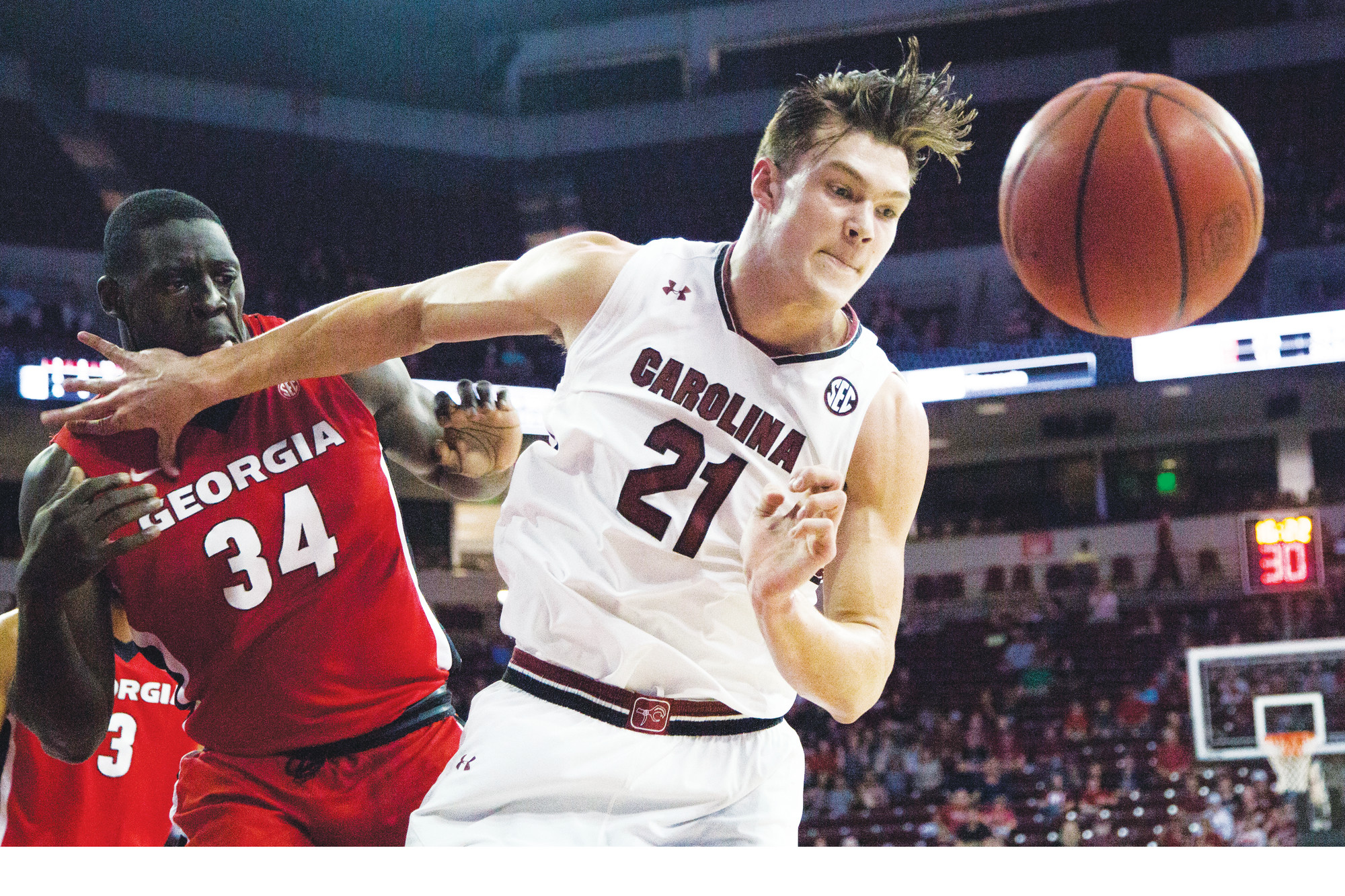 South Carolina forward Maik Kotsar (21) keeps Georgia forward Derek Ogbeide (34) away from the ball during the Gamecocks 66-57 victory over the Bulldogs on Wednesday in Columbia.