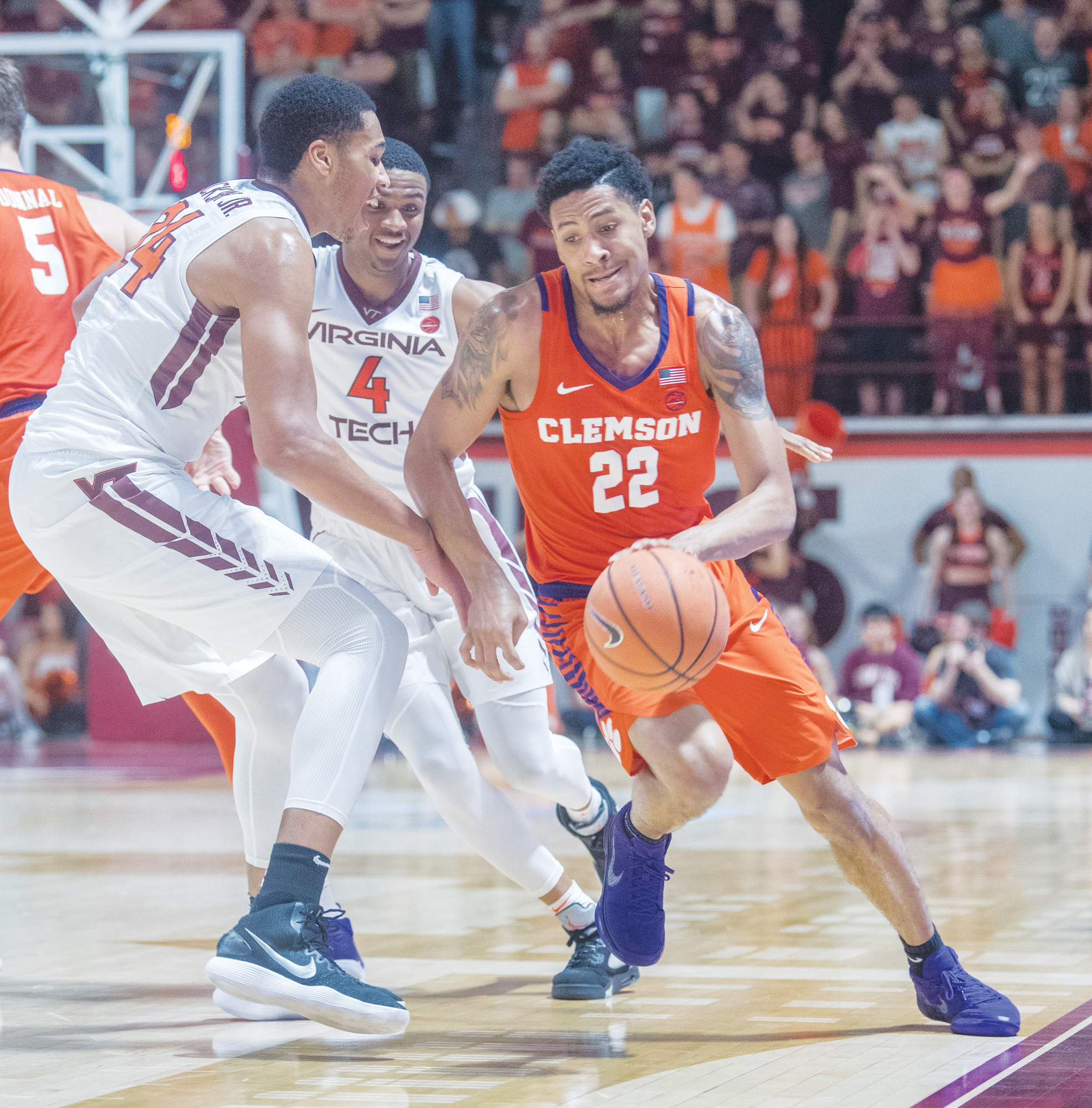 Virginia Tech forward Kerry Blackshear Jr. (24) guards Clemson guard Scott Spencer (22) during the first half of the Hokies' 65-58 victory over a reeling Clemson squad on Wednesday in Blacksburg, Virginia.