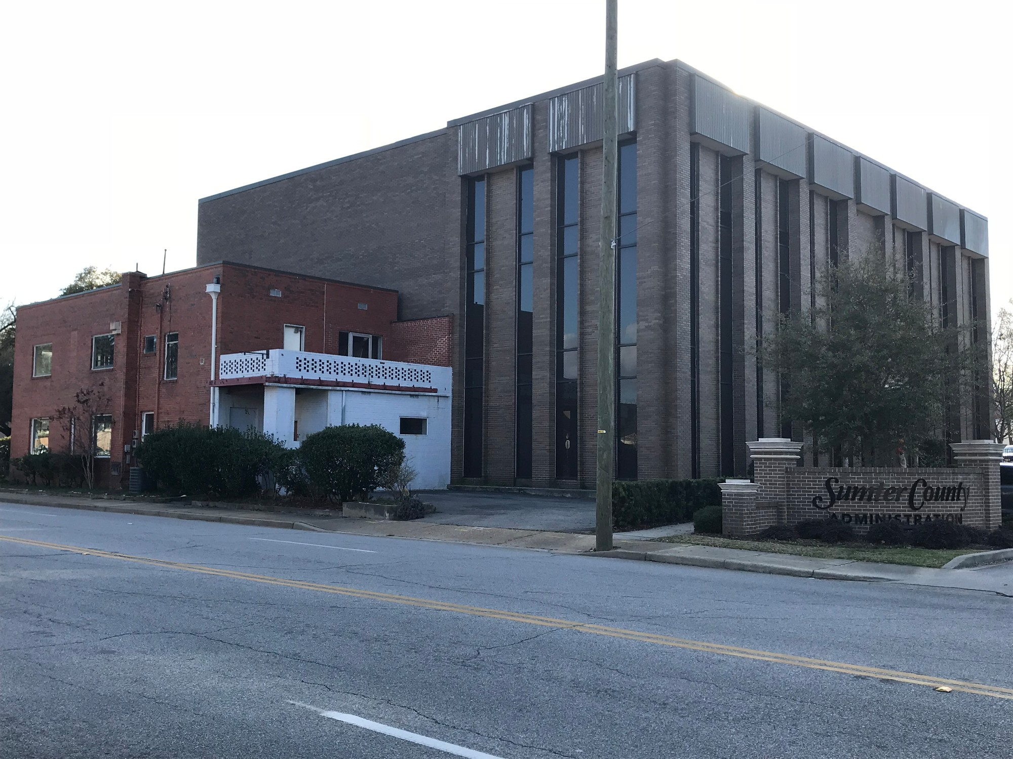 The vacant, red brick building next to the Sumter County Administration Building will be demolished and a building will provide public access to county agencies will be constructed in its place.