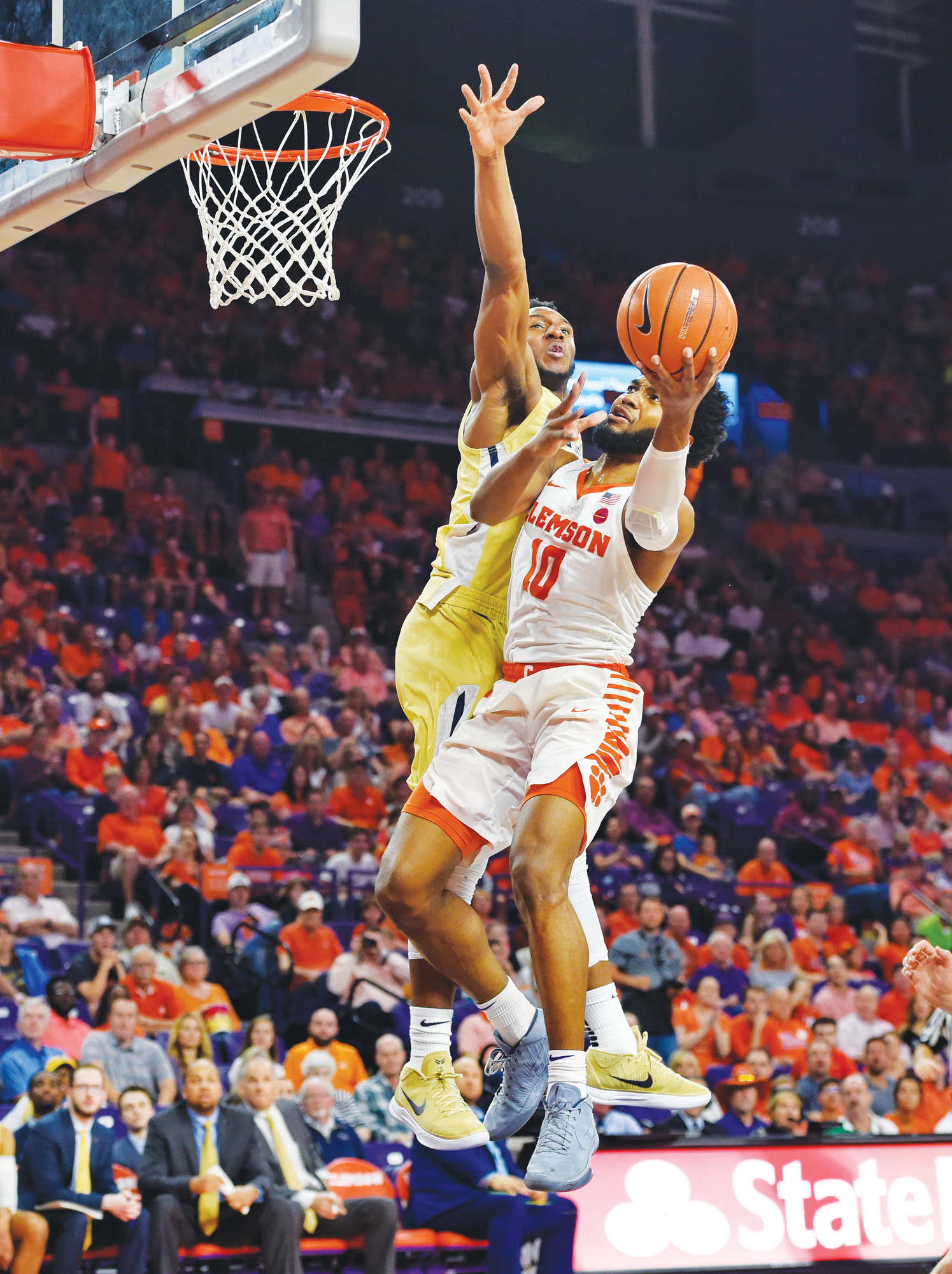Clemson's Gabe DeVoe (10) drives to the basket while defended by Georgia Tech's Josh Okogie during the first half of the Tigers 75-67 victory over the Yellow Jackets on Saturday in Clemson.