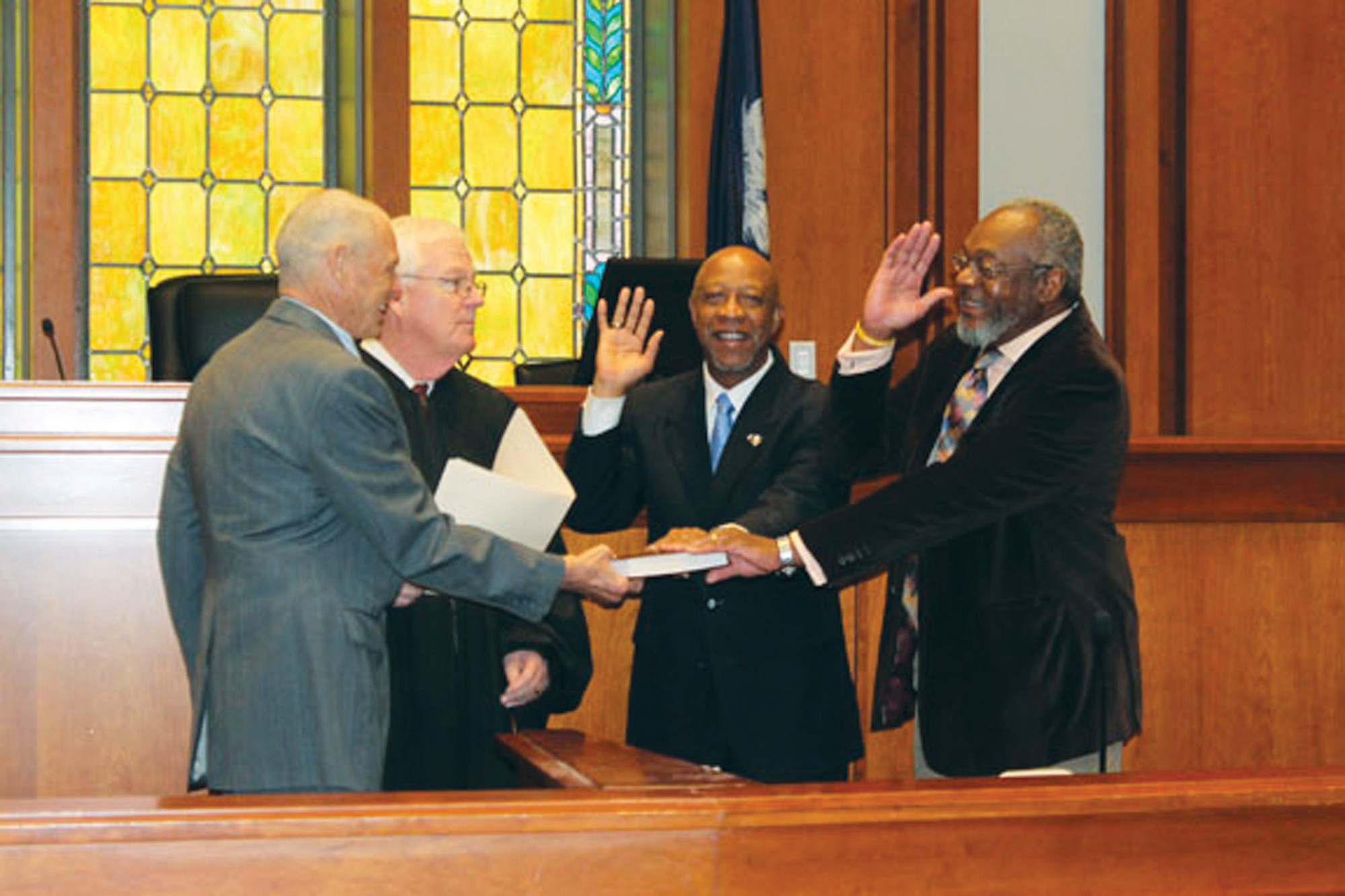 "Albert Mobley and Charles H. Jackson were sworn in as Clarendon County   deputy coroners by Third Circuit Court Judge R. Ferrell Cothran Jr. on Wednesday in the main courtroom at Clarendon   County Courthouse. Newly sworn in   Clarendon County Coroner Charles ""Bucky"" Mock holds the Bible during   their swearing-in ceremony."