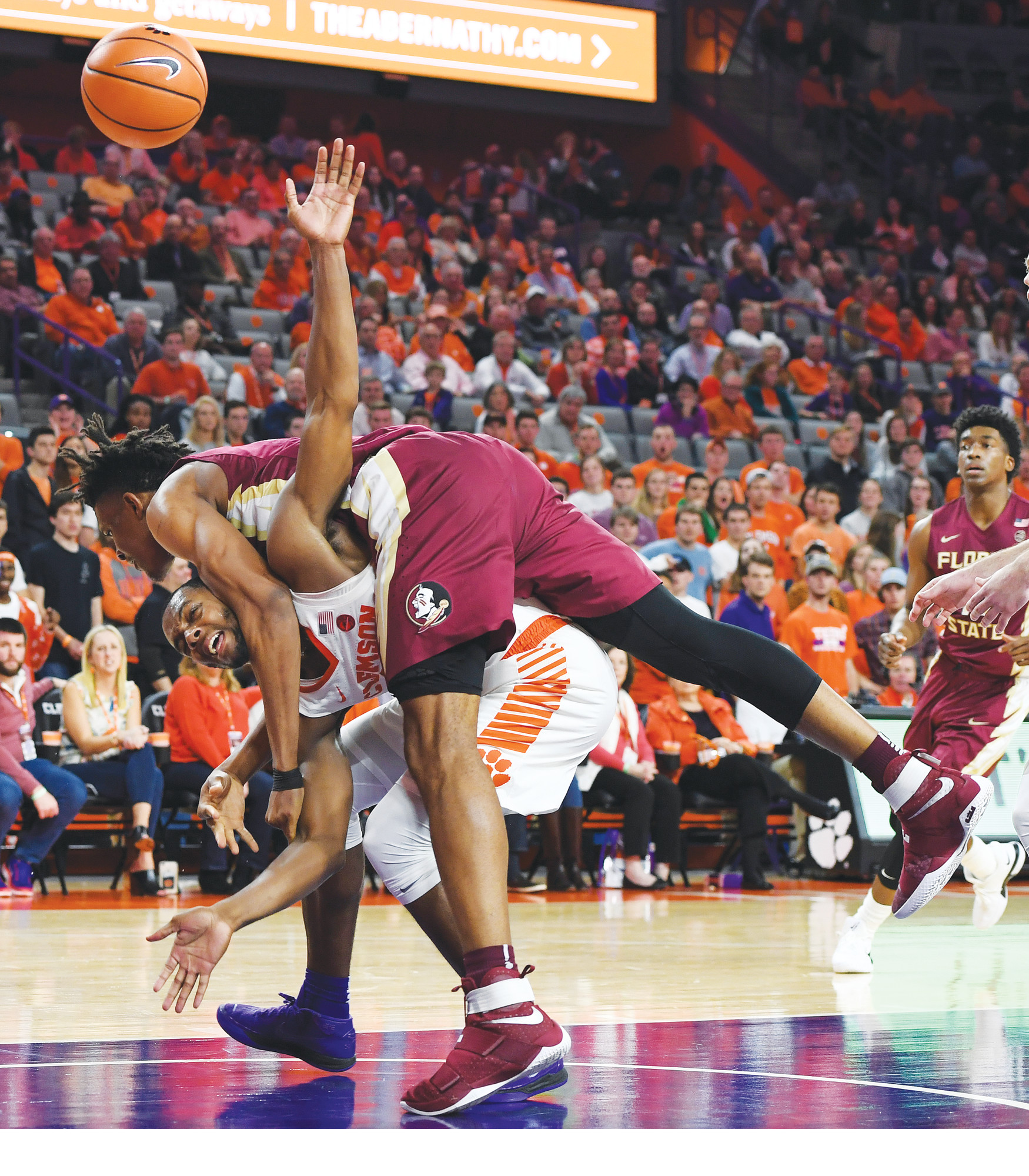 THE ASSOCIATED PRESS  Florida State center Ike Obiagu, top, fouls Clemson forward Aamir  Simms during the second half of the Tigers' 76-63 victory on Wednesday in Clemson.