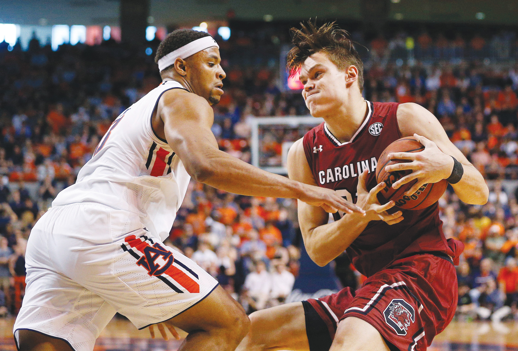 South Carolina forward Maik Kotsar, right, drives the ball to the basket against Auburn forward Desean Murray during the first half of Auburn's victory over the Gamecocks on Saturday in Auburn, Alabama.