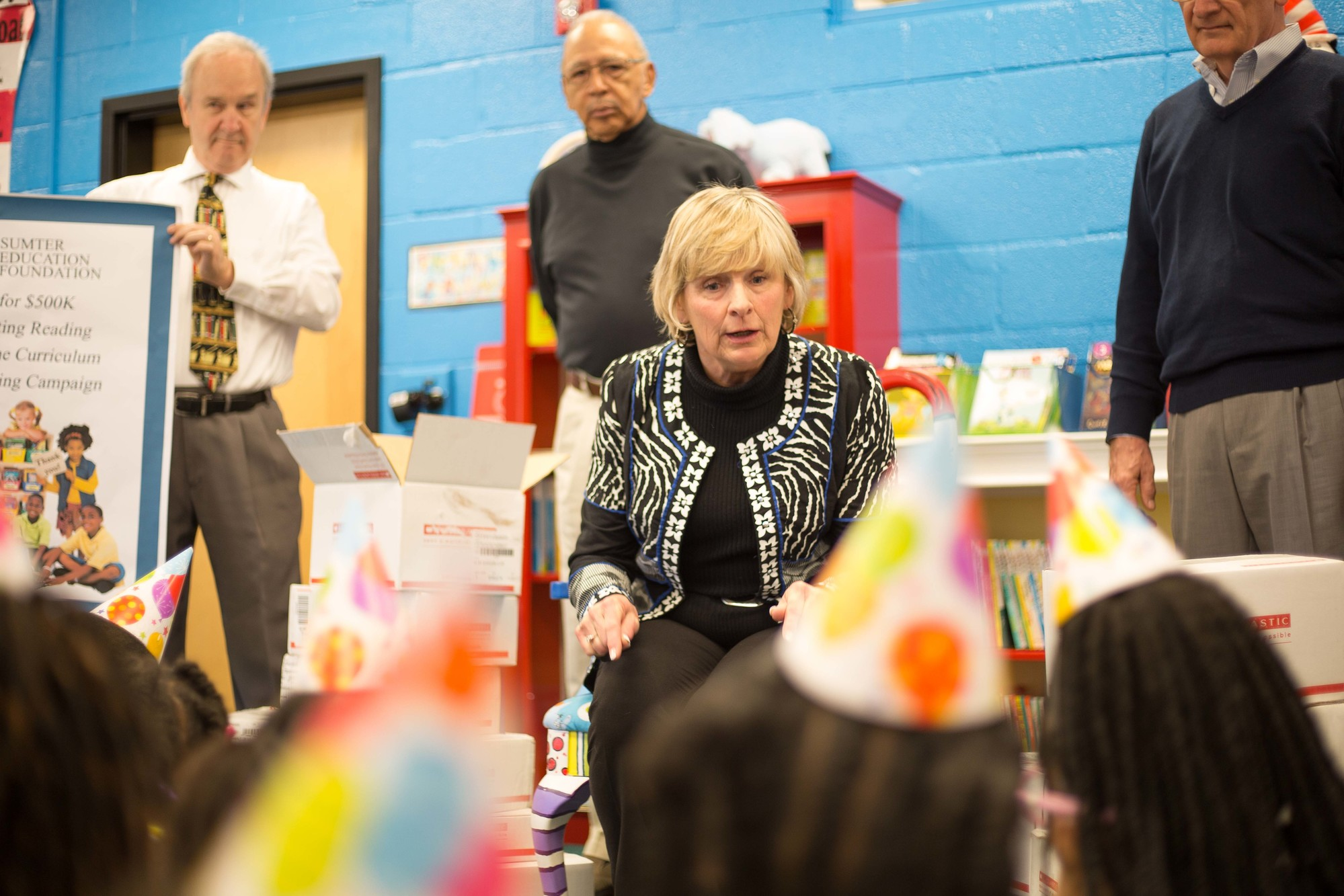 Susan Hilton, a member of the Sumter Education Foundation Board of Directors and retired Sumter High School teacher, tells second-graders at R.E. Davis Elementary School about the books the group donated to the school on Friday.
