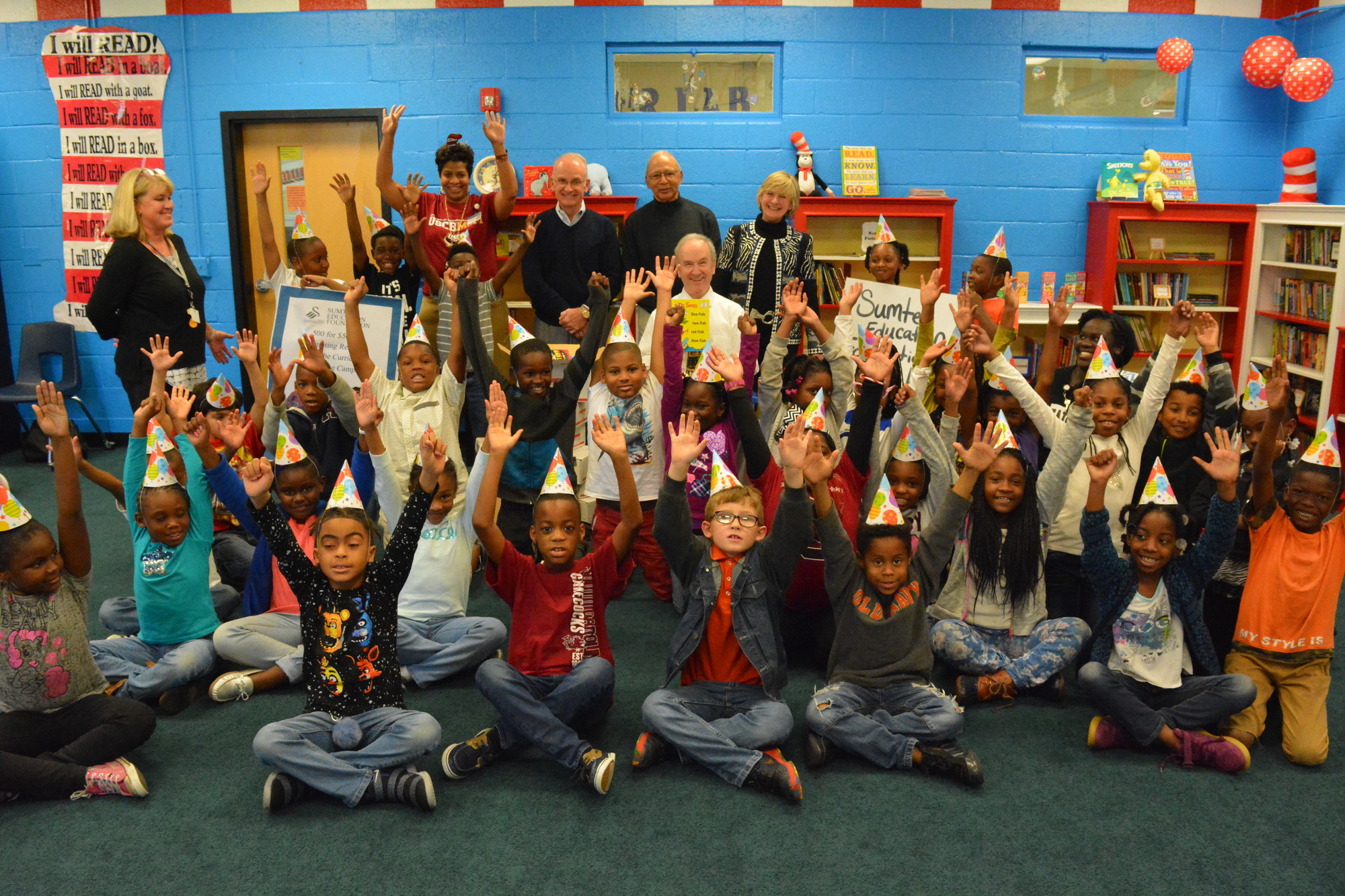 Students celebrated Read Across America Day on Friday with new books in their classroom libraries given to their school by