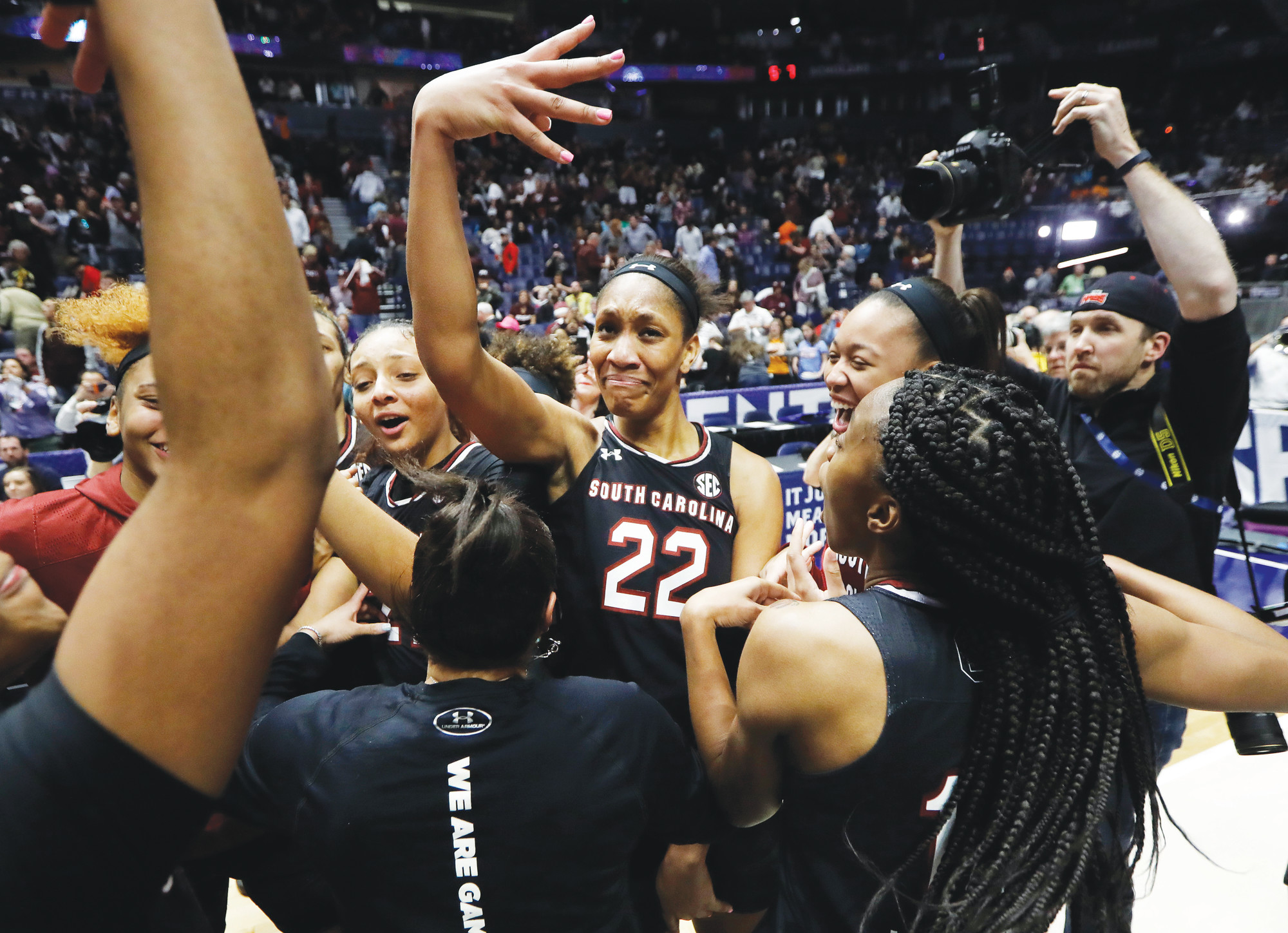 THE ASSOCIATED PRESSSouth Carolina's A'ja Wilson (22) celebrates with her teammates after the Gamecocks defeated Mississippi State 62-51 to win the Southeastern Conference tournament championship for the fourth straight season on Sunday in Nashville, Tenn. USC snapped the Bulldogs' 32-game winning streak as well.