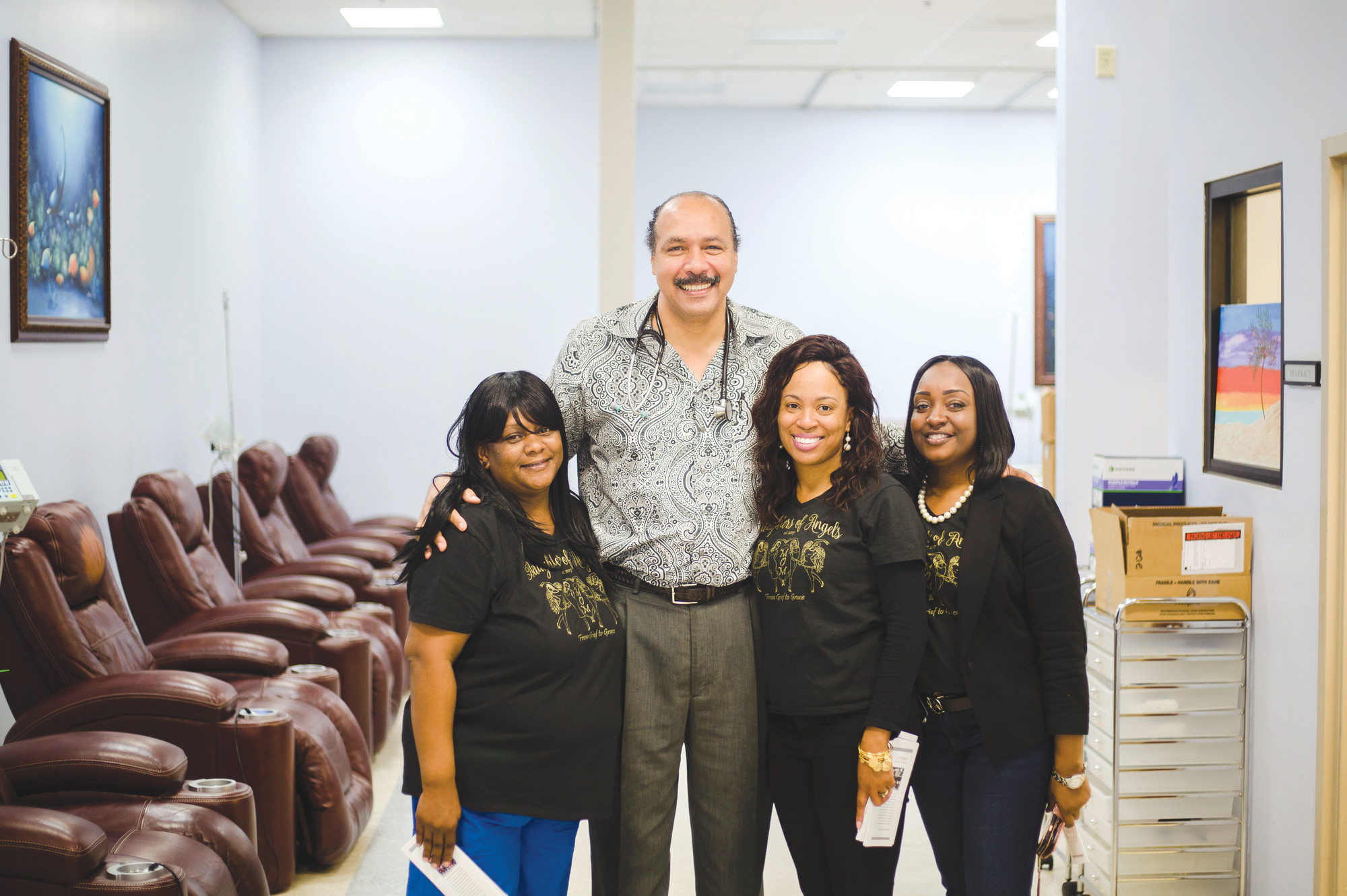 Dr. Billy Clowney is seen with members of Daughters of Angels after the group delivered gift bags to Santee Hematology and Oncology on Friday. Clowney helped treat each of the members' mothers during their fights with cancer.