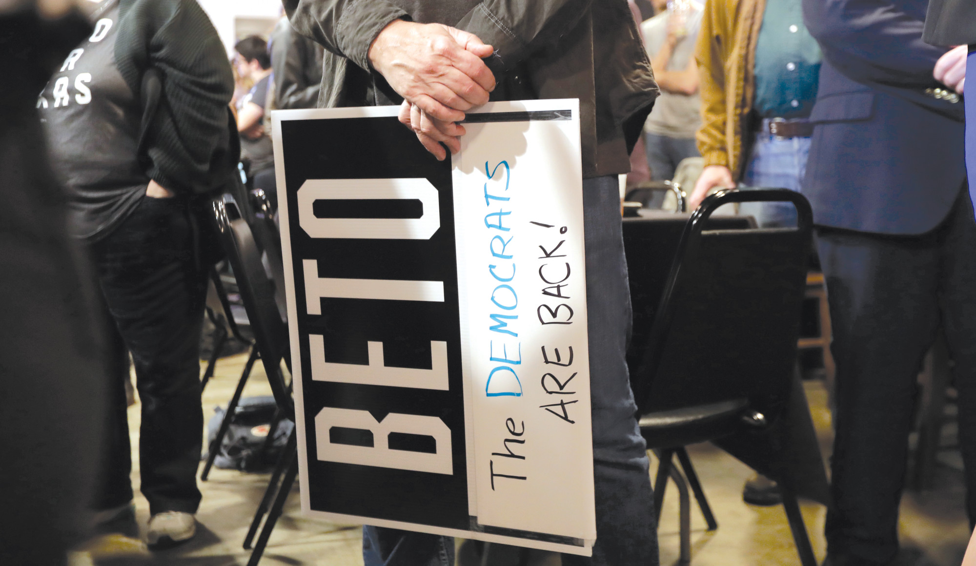 A supporter of senate hopeful Beto O'Rourke holds a sign during a Democratic watch party following the Texas primary election on Tuesday in Austin, Texas.