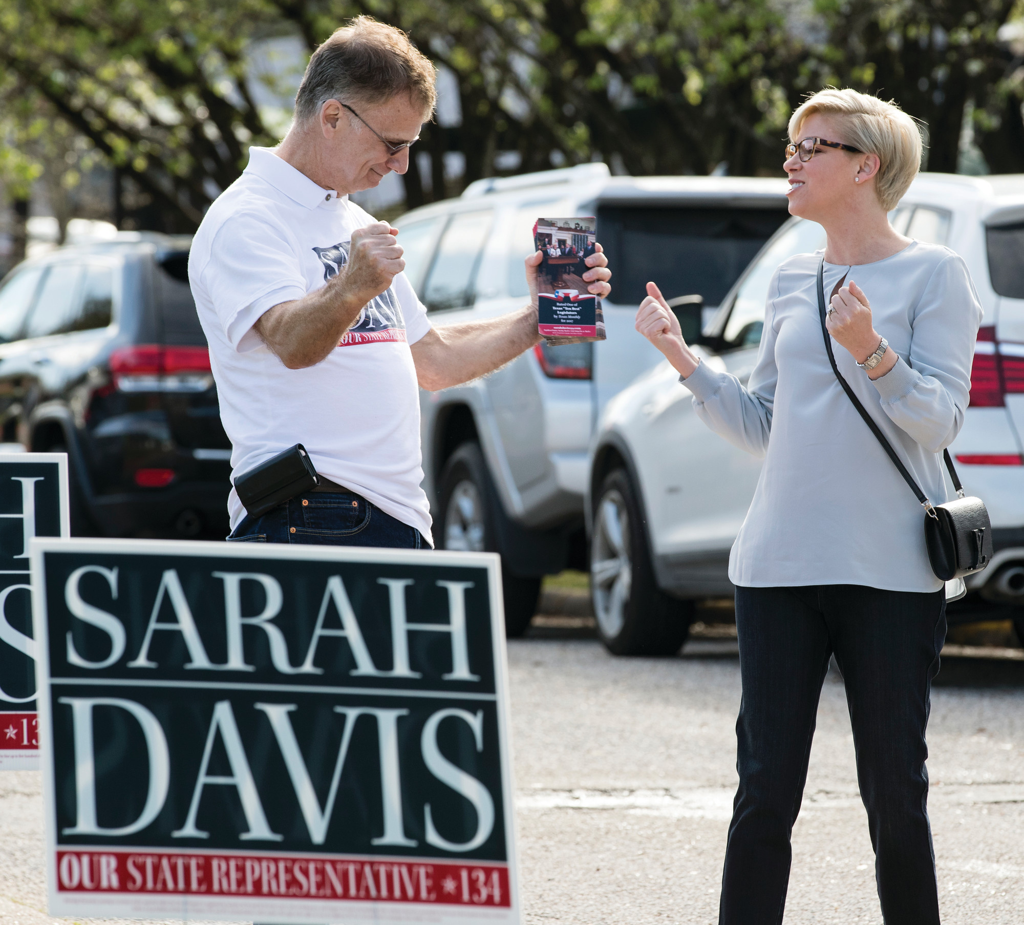 State Rep. Sarah Davis, R-Houston, speaks to campaign volunteer Michael Sternesky before voting in the primary election outside the polling place at West University Elementary School on Tuesday in Houston. Davis was running for re-election in the Texas House of Representatives, District 134.