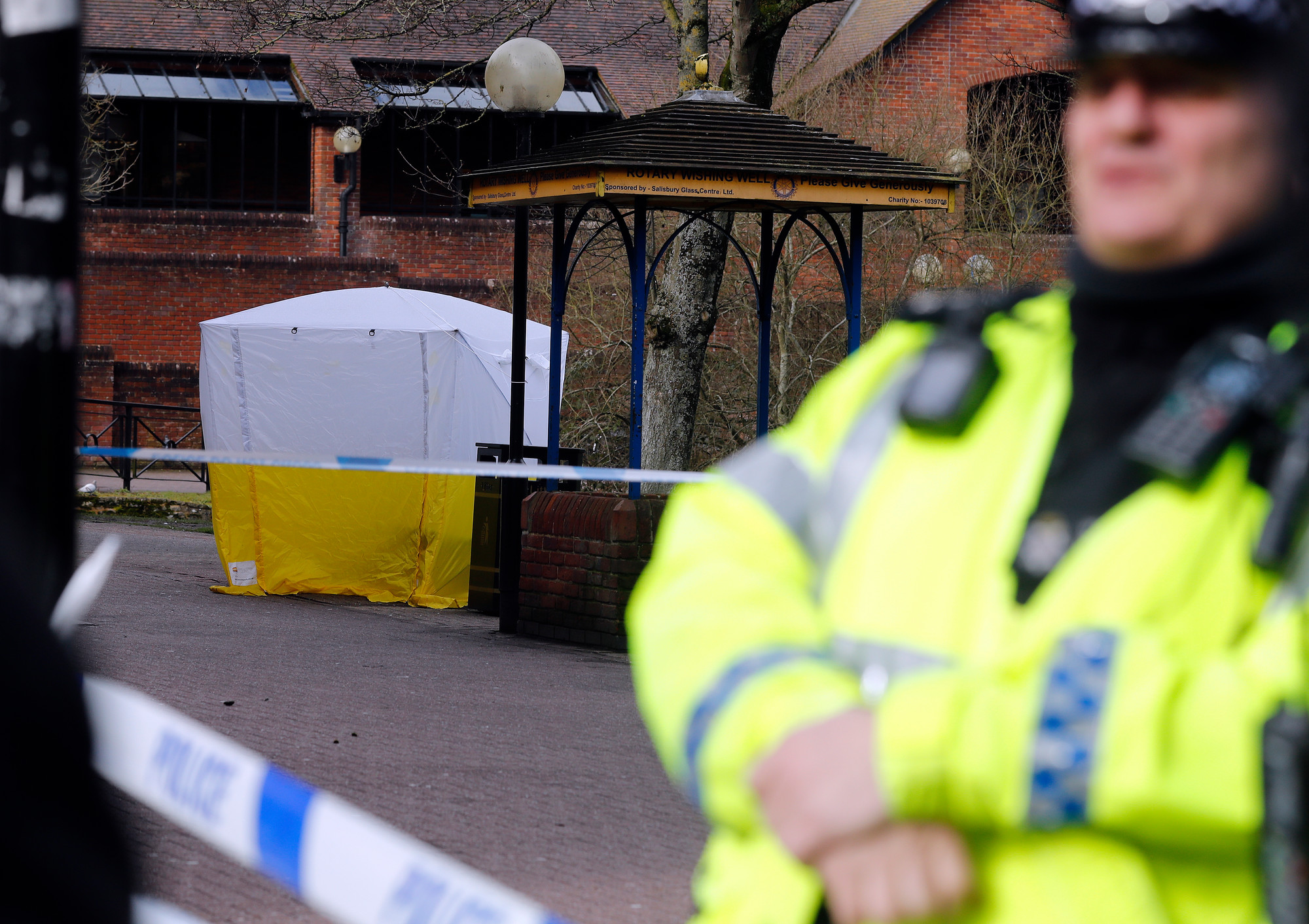 "A police tent covers the the spot where former Russian double agent Sergei Skripal and his companion were found critically ill Sunday following exposure to an ""unknown substance"" in Salisbury, England, on Tuesday.  66-year old Skripal, and unidentified woman companion are being treated in hospital, after they were found unconscious on the park bench."