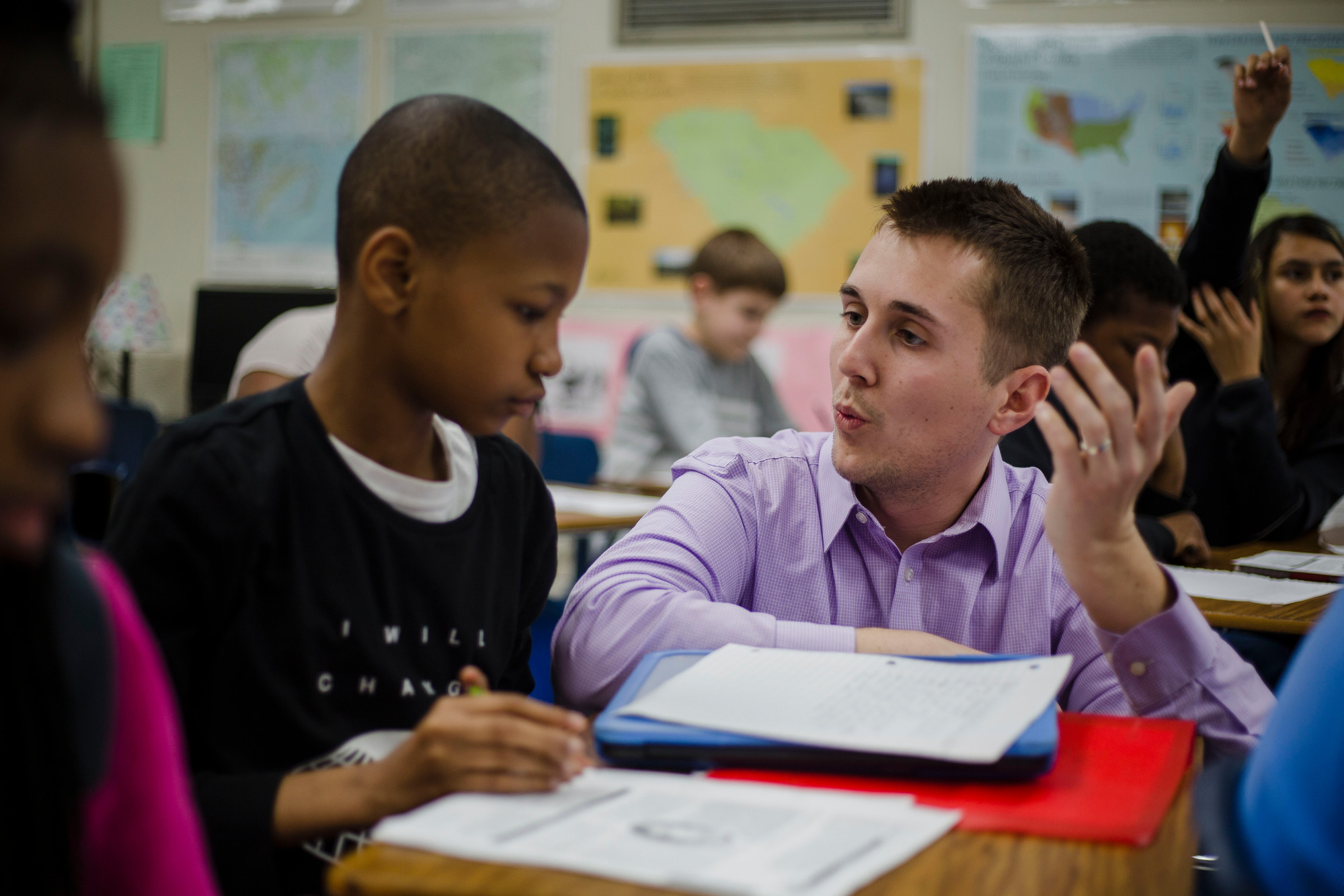 Zachariah Lowe helps a student in his classroom at Mayewood Middle School on Tuesday.