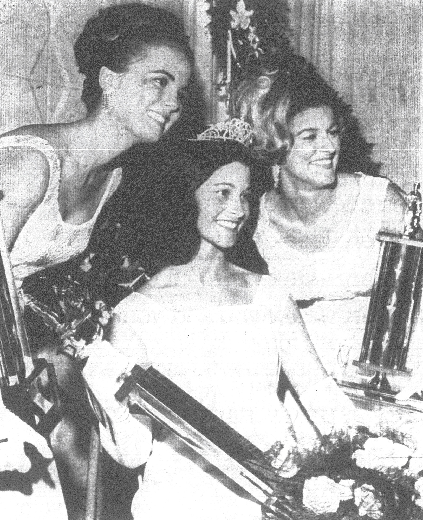 1968 - Newly crowned 1968 Queen Iris Roberta Mathis of Manning is flanked on the left by first runner-up Judy Ann Christensen, Miss Hartsville, and on the right by second runner-up Dayle Marchette. Roberta Mathis will be the reigning queen for the 1969 version of Sumter's world-famous Iris Festival.