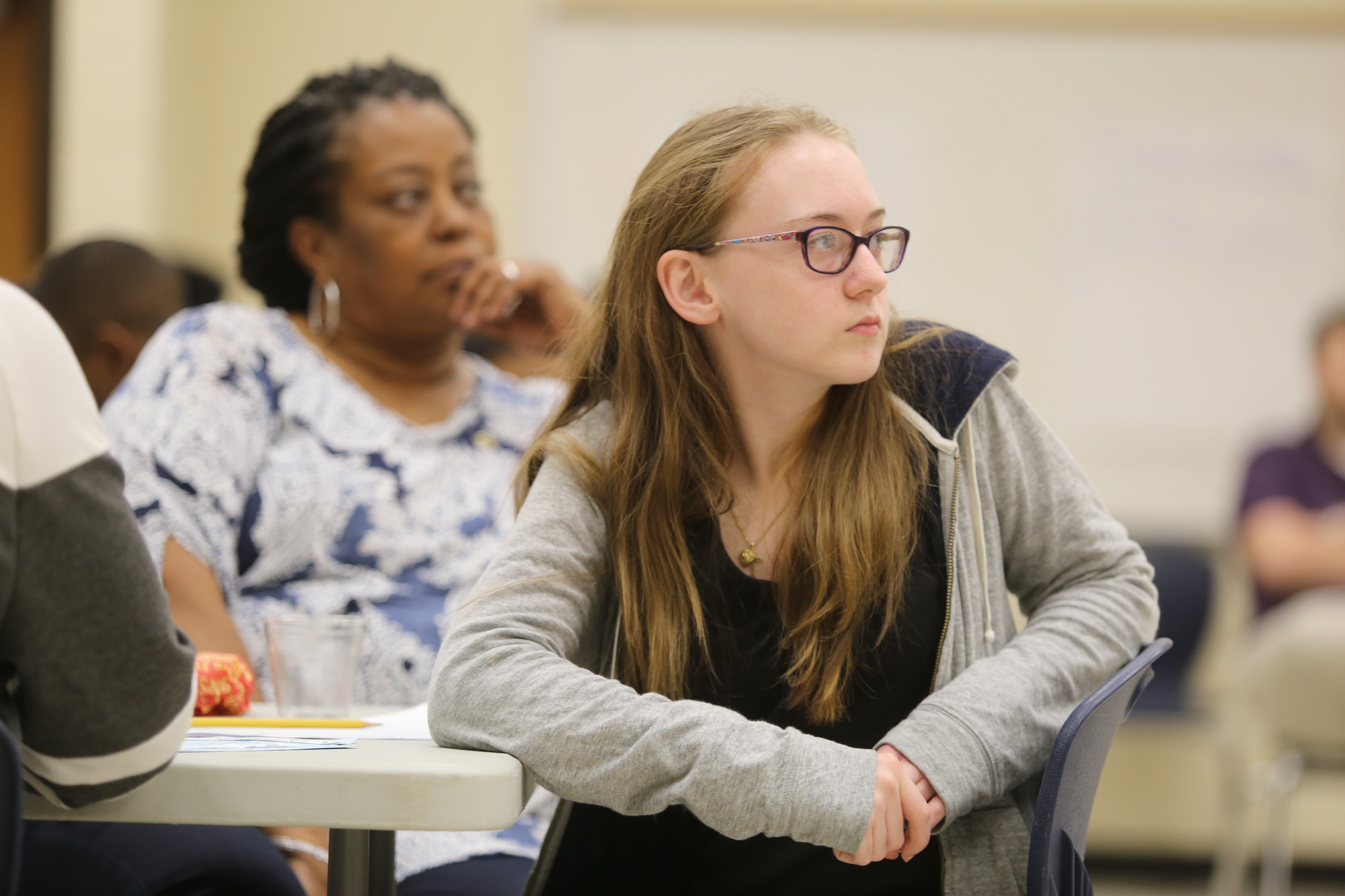 Bates Middle School student Andreanna McAlister listens Wednesday to discussion on social media as adult volunteer Tracey Johnson looks on in the background. The two are participants in the school's intergenerational program this year.