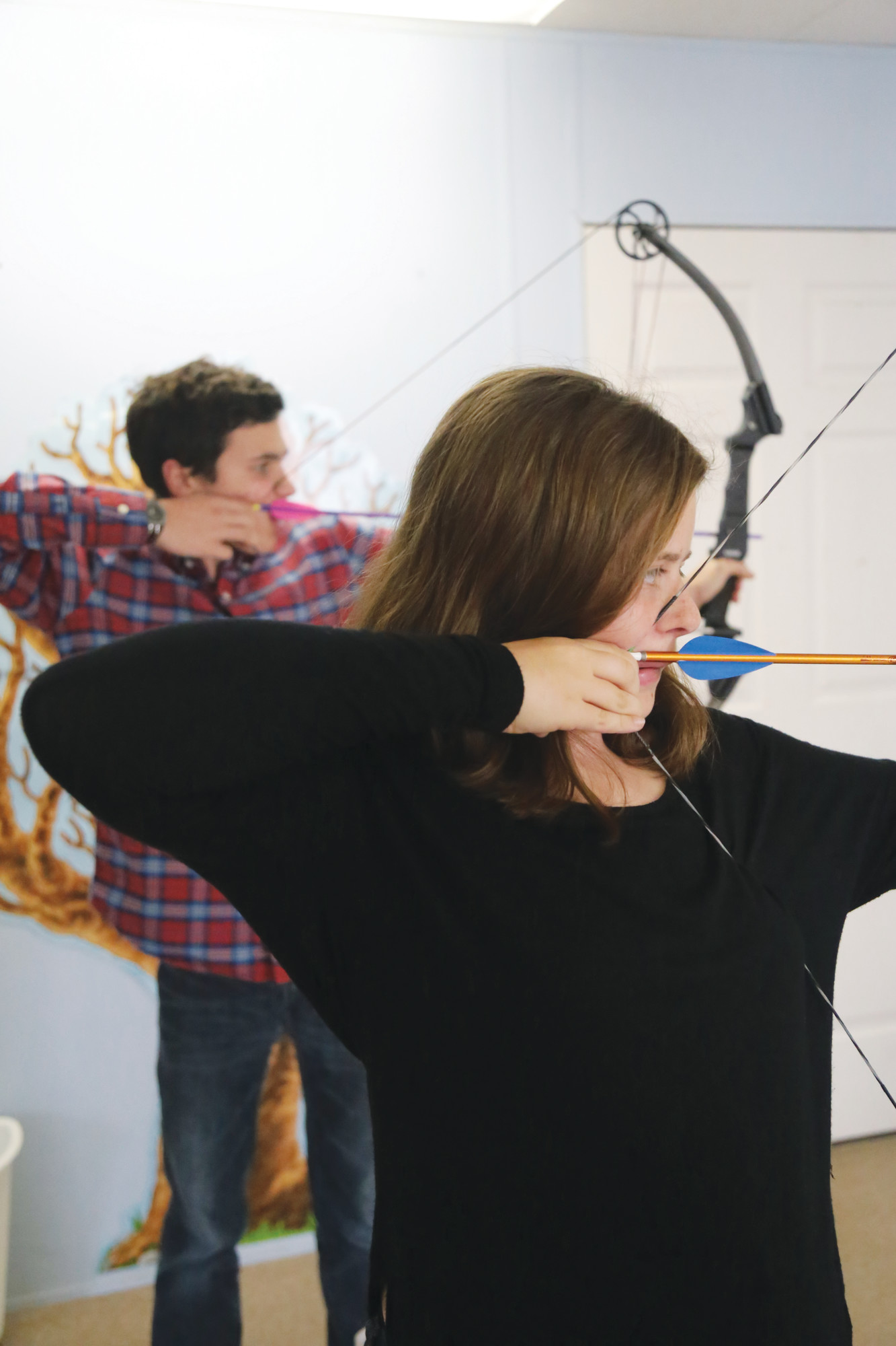 Thomas Sumter Academy archery team members Madeleine Britton (foreground) and Tyler Singletary (back) shoot during a recent practice session at the Dalzell school. The TSA archery team recently won its second straight SCISA state championship and the elementary and high school teams will compete in the upcoming National Archery in the Schools Program state tournament to be held March 27-29 at Sumter County Civic Center.